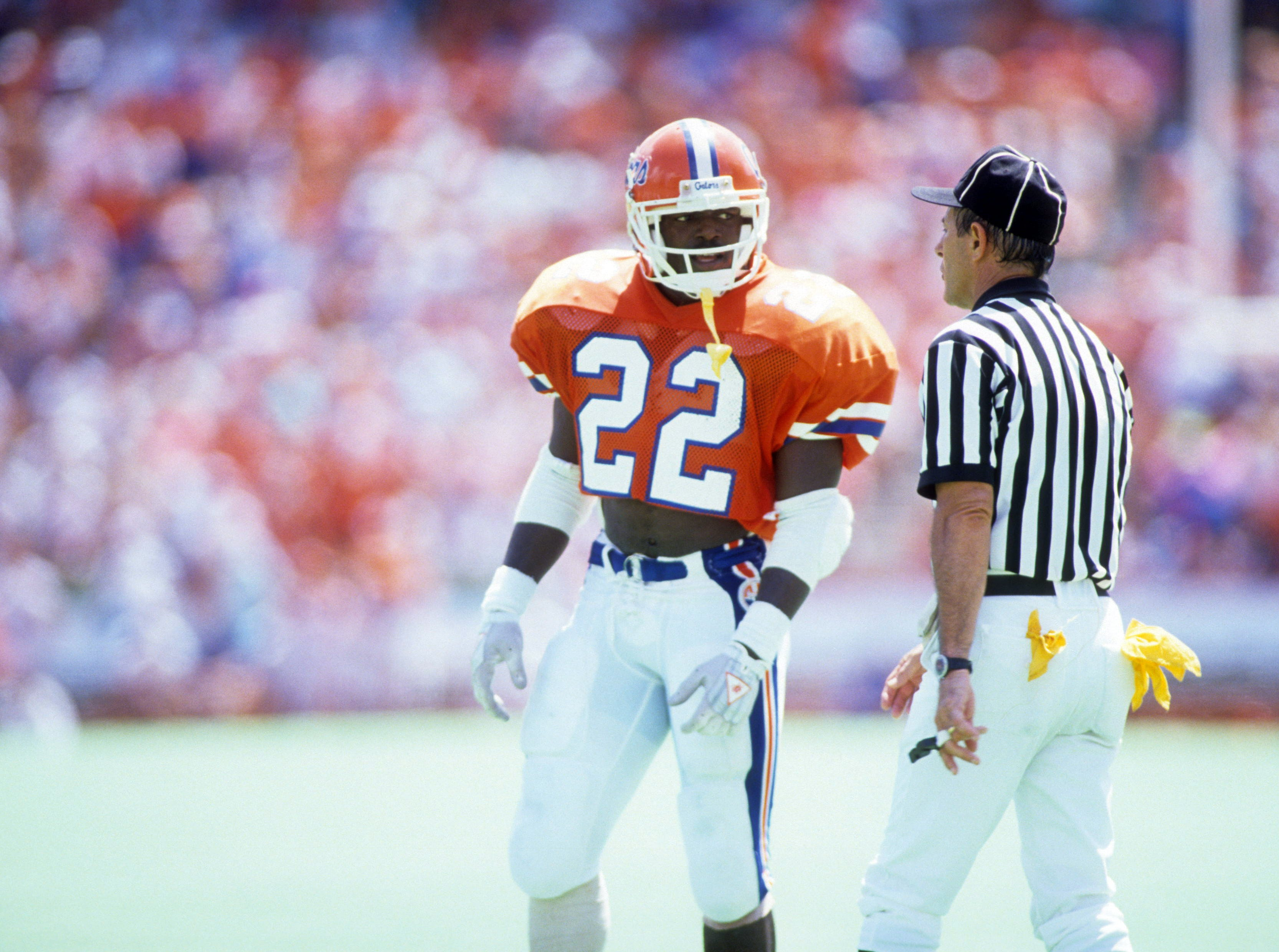 GAINSVILLE, FL - SEPTEMBER 9:  Running back Emmitt Smith #22 of the Florida Gators talks with the referee during a game against the Ole Miss Rebels at Ben Hill Griffin Stadium on September 9,1989 in Gainsville, Florida. The Rebels defeated the Gators 24-19.  (Photo by Allen Dean Steele/Getty Images)