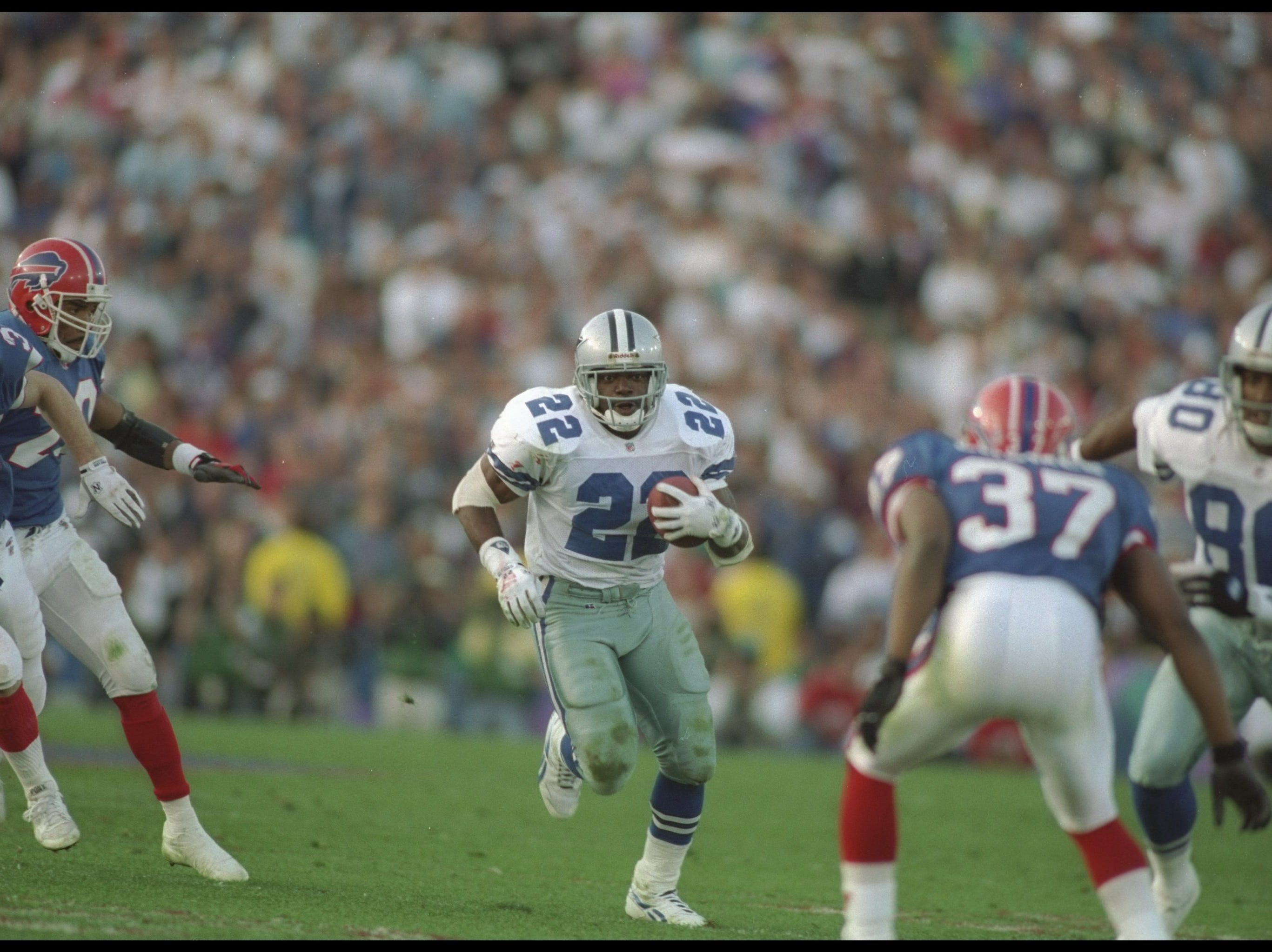 Running back Emmitt Smith of the Dallas Cowboys moves the ball during Super Bowl XXVII against the Buffalo Bills at the Rose Bowl in Pasadena, California.  The Cowboys won the game, 52-17. Mandatory Credit: Mike Powell  /Allsport