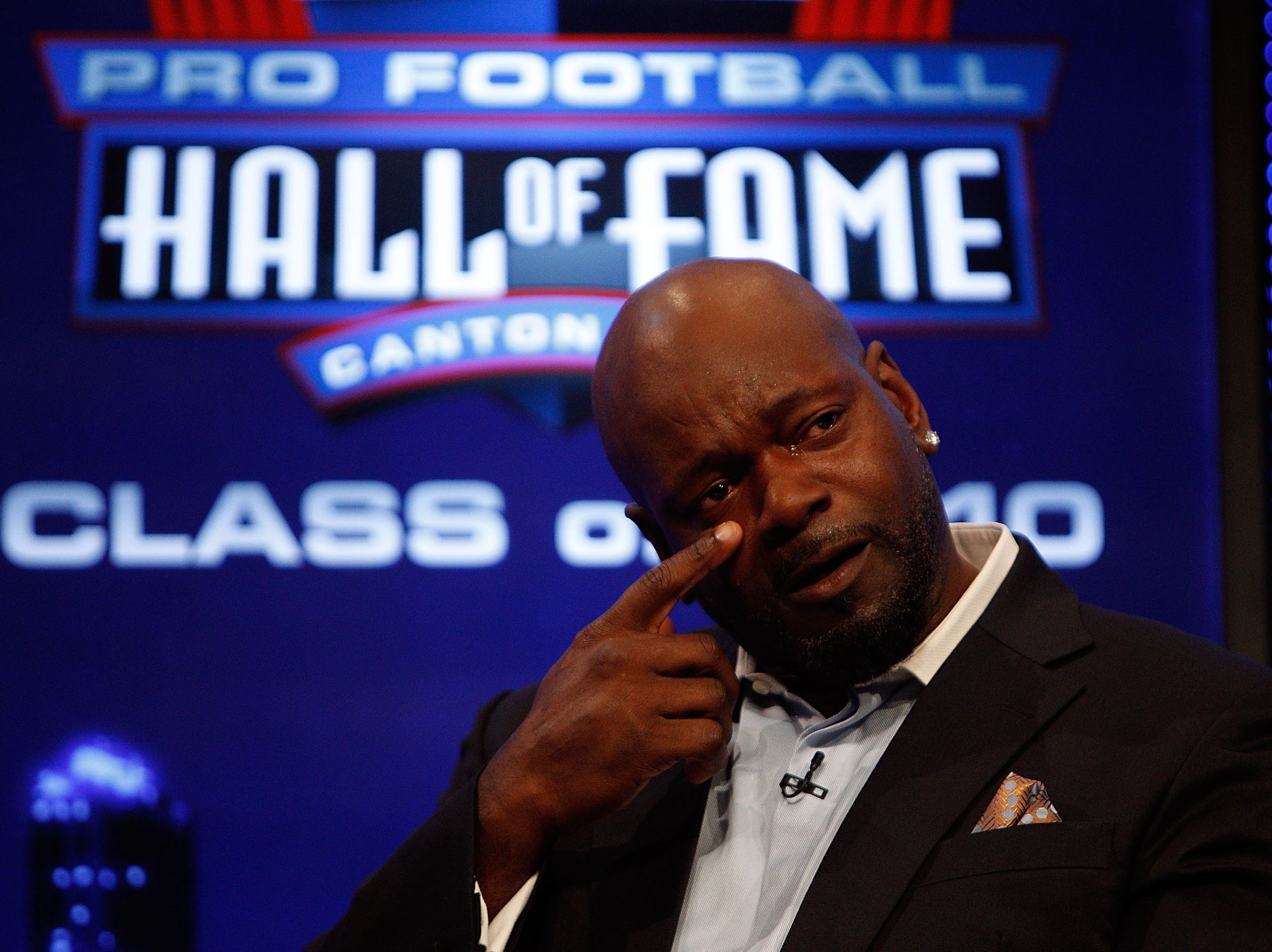 FORT LAUDERDALE, FL - FEBRUARY 06:  Emmitt Smith is overcome with emotion on stage after he was announced as one of the newest enhrinees into the Hall of Fame during the Pro Football Hall of Fame Class of 2010 Press Conference held at the Greater Ft. Lauderdale/Broward County Convention Center as part of media week for Super Bowl XLIV on February 6, 2010 in Fort Lauderdale, Florida.  (Photo by Chris Graythen/Getty Images)