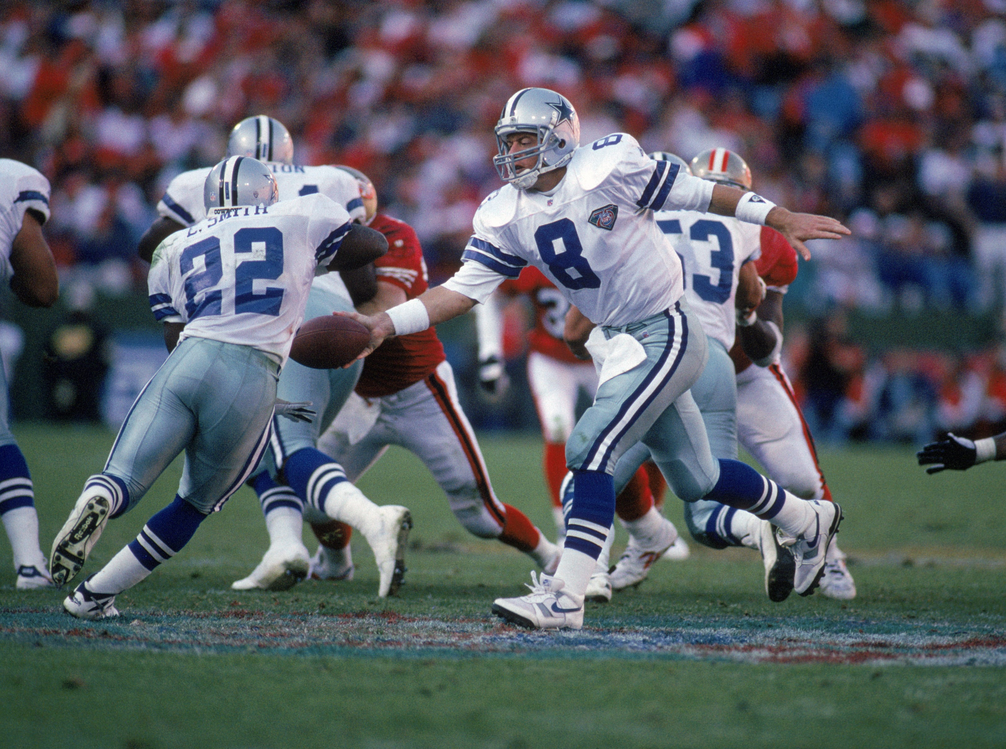 SAN FRANCISCO - NOVEMBER 13:  Quarterback Troy Aikman #8 of the Dallas Cowboys hands off the bal to running back Emmitt Smith #22 during a game against the San Francisco 49ers at Candlestick Park on November 13, 1994 in San Francisco, California.  The 49ers won 21-14.  (Photo by George Rose/Getty Images)