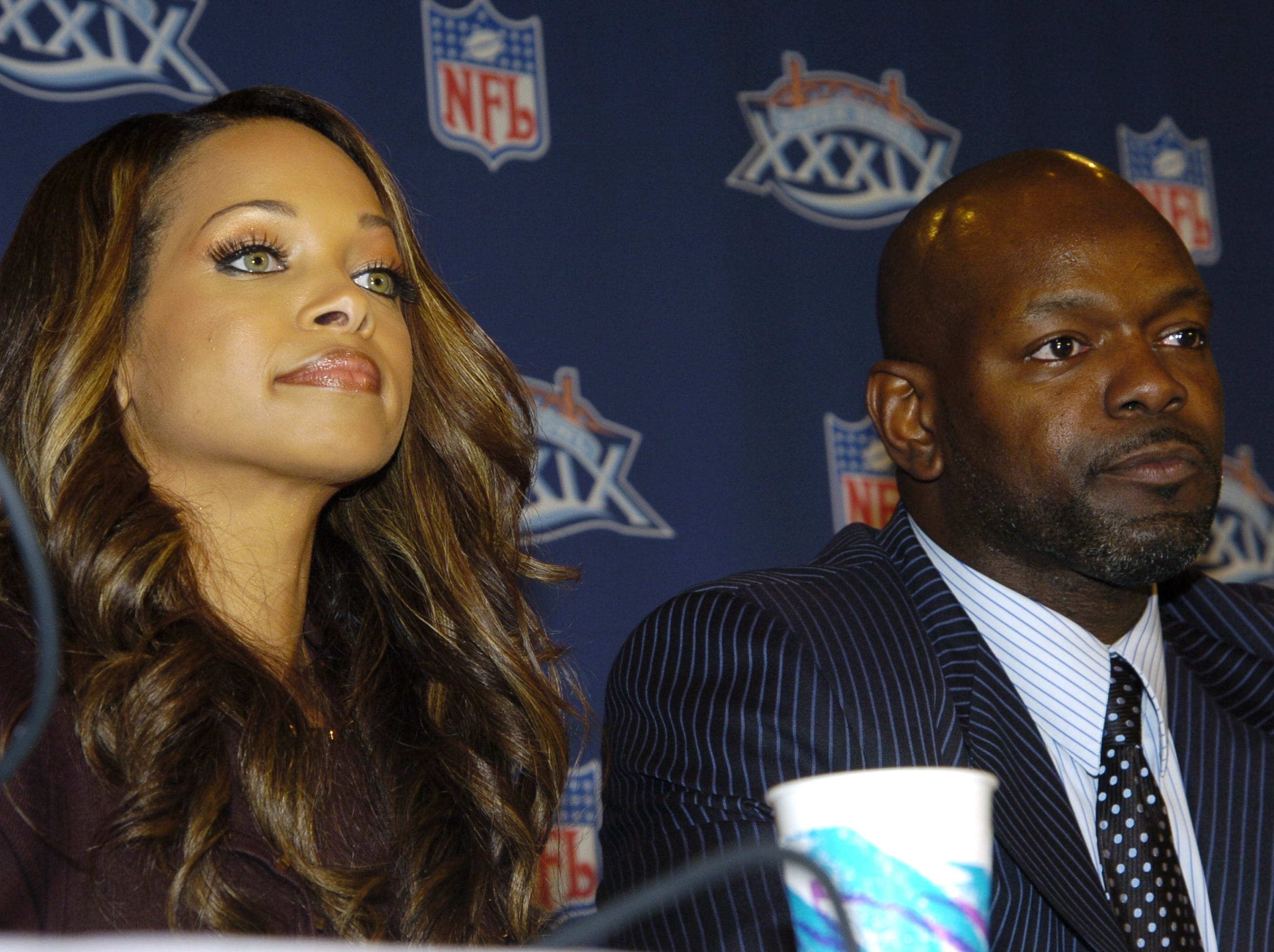Emmitt Smith sits next to his wife Pat  as he announcing his retirement from the NFL after 15 years during a press conference on February 3, 2005 at the Prime F. Osborn III Convention Center in Jacksonville, Florida on February 3, 2005  (Photo by Al Messerschmidt/Getty Images)