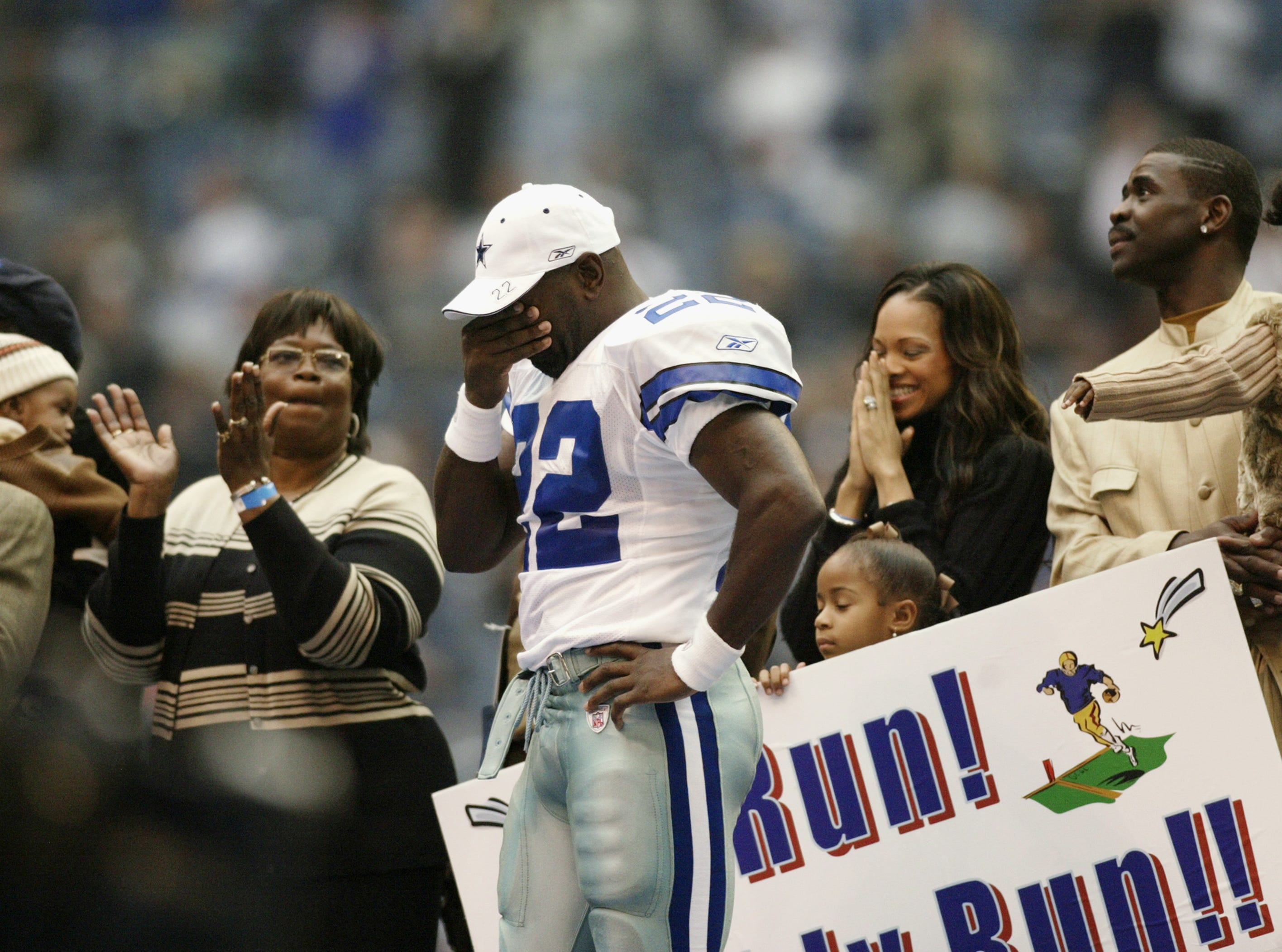 "IRVING, TX - OCTOBER 27:   Running Back Emmitt Smith #22 of the Dallas Cowboys is emotional for being celebrated as the ""All Time Leading Rusher"" during the NFL game against the Seattle Seahawks at Texas Stadium on October 27, 2002 in Irving, Texas. The Seahawks defeated the Cowboys 17-14. (Photo by Ronald Martinez/Getty Images)"