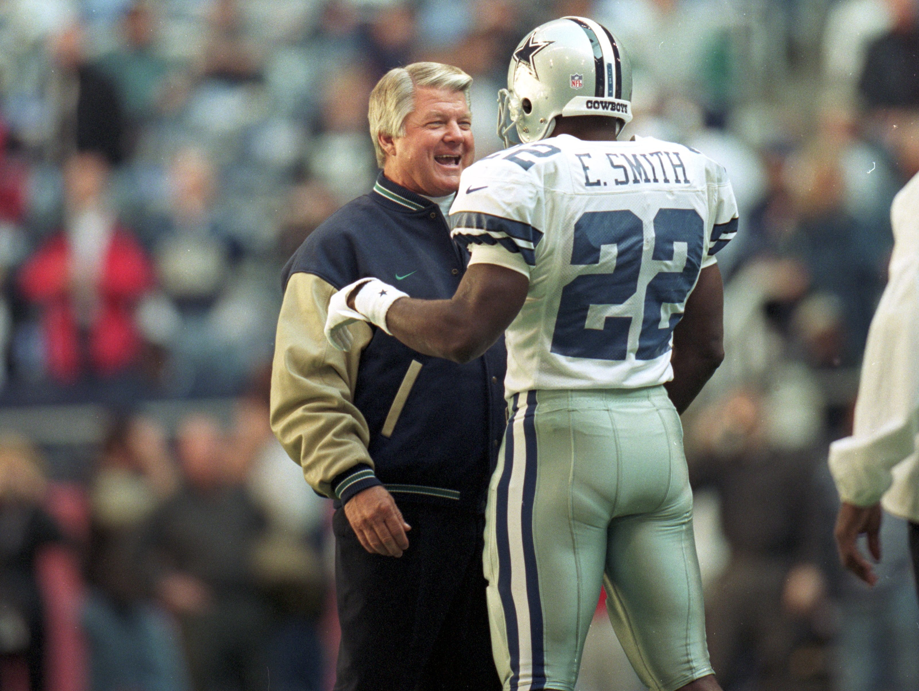 25 Nov 1999: Head coach Jimmy Johnson of the Miami Dolphin visits with Emmitt Smith #22 of the Dallas Cowboys before the game at the Texas Stadium in Irving, Texas. The Cowboys defeated the Dolphins 20-3. Mandatory Credit: Ronald Martinez  /Allsport