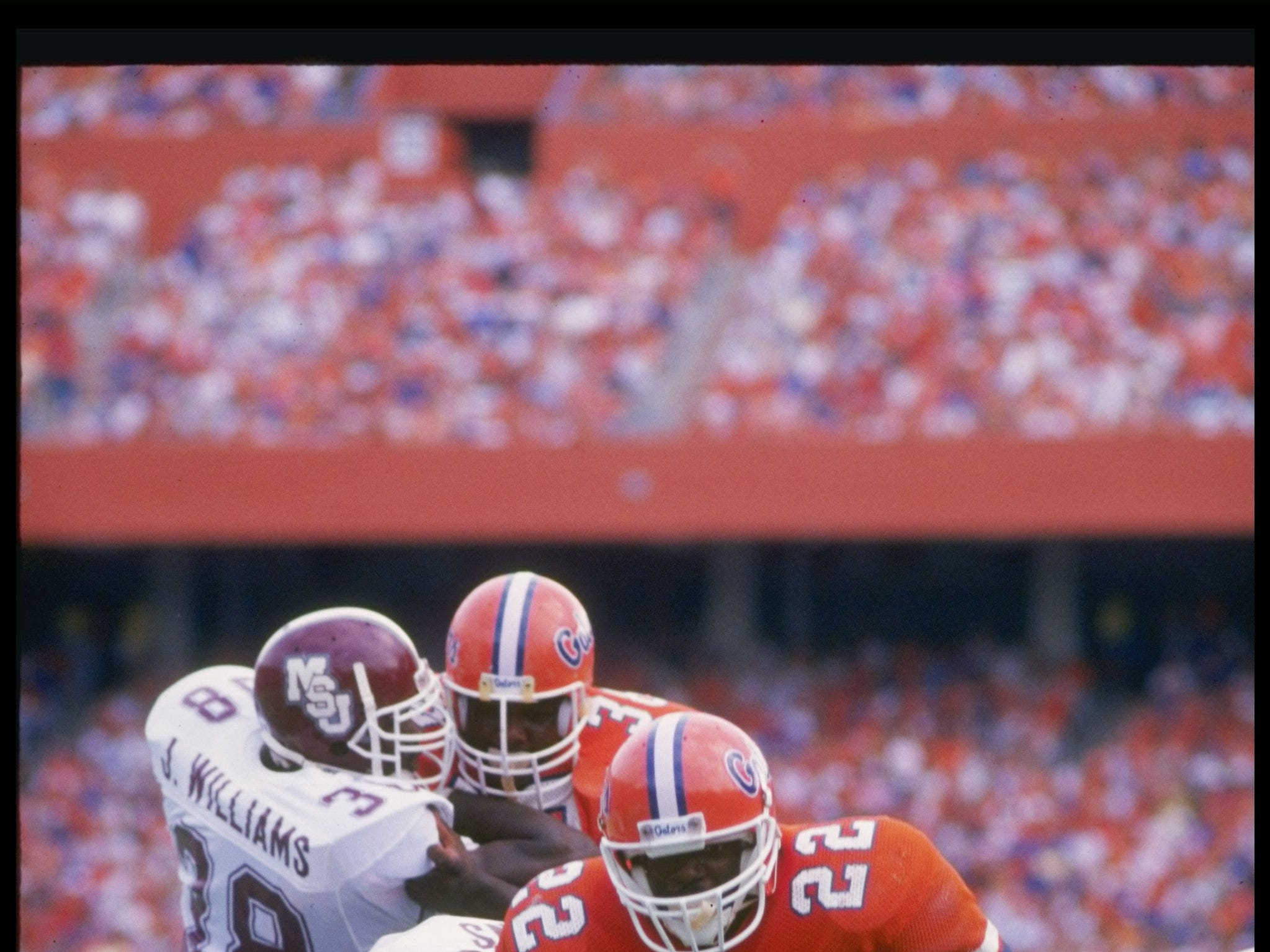 1988:  Running back Emmitt Smith of the Florida Gators runs down the field during a game against the Mississippi State Bulldogs at Florida Field in Gainesville, Florida.  Mandatory Credit: Allen Dean Steele  /Allsport