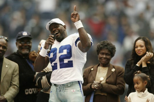 Running back Emmitt Smith of the Dallas Cowboys celebrates breaking the NFL rushing record during a game against the Seattle Seahawks on Oct. 27, 2002, at Texas Stadium in Irving, Texas.