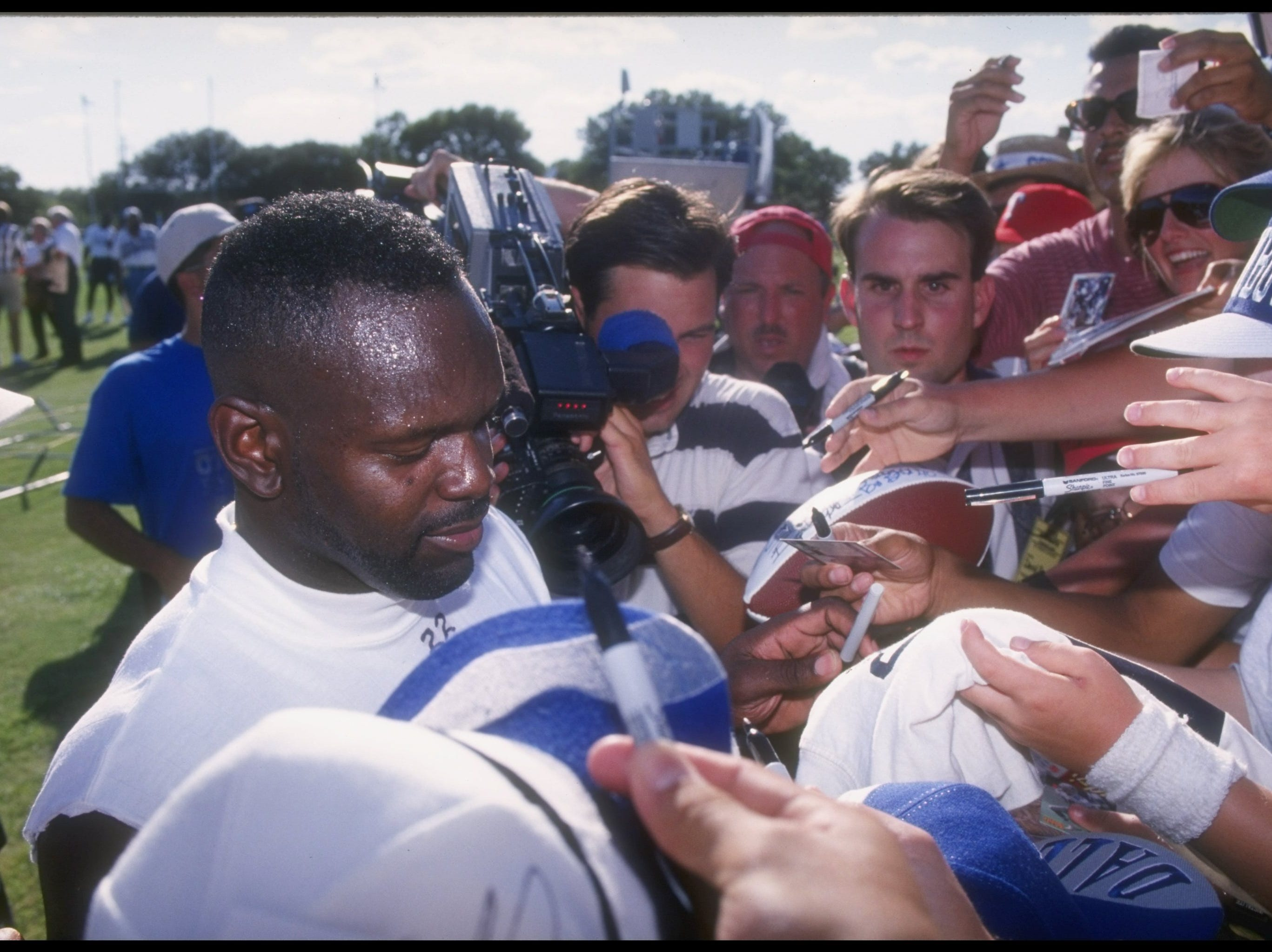 21 Jul 1995:  Running back Emmitt Smith of the Dallas Cowboys talks to the press during training camp in Austin, Texas. Mandatory Credit: Stephen Dunn  /Allsport