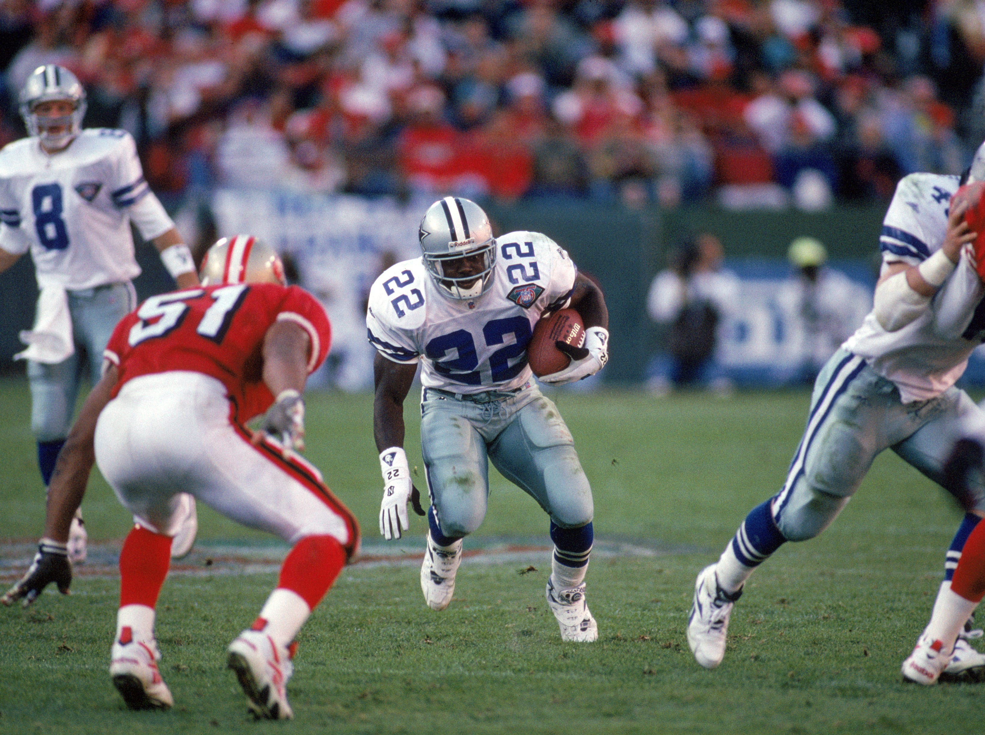 SAN FRANCISCO - NOVEMBER 13:  Running back Emmitt Smith #22 of the Dallas Cowboys rushes for yards during a game against the San Francisco 49ers at Candlestick Park on November 13, 1994 in San Francisco, California.  The 49ers won 21-14.  (Photo by George Rose/Getty Images)