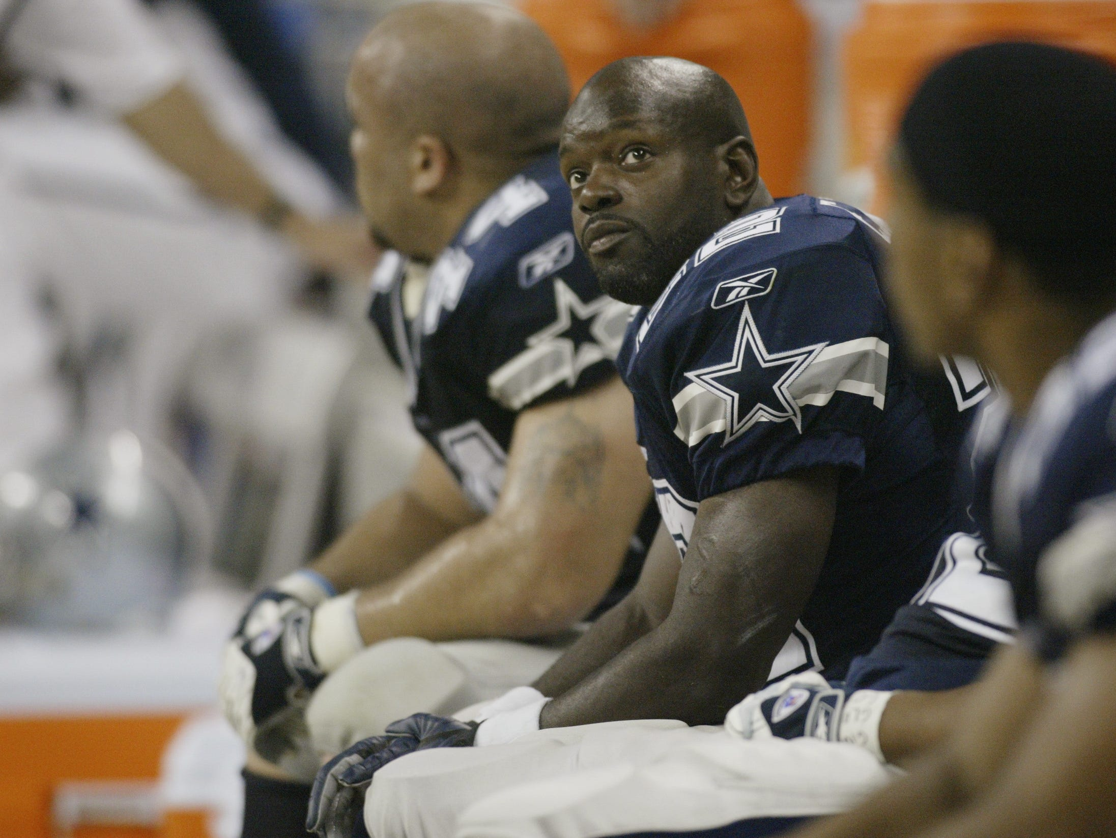HOUSTON, TX - SEPTEMBER 8:  Running back Emmitt Smith #22 of the Dallas Cowboys sits on the bench and looks at the scoreboard during NFL game against the Houston Texans on September 8, 2002 at Reliant Stadium in Houston, Texas. The Texans won their first regular season game 19-10.  (Photo by Ronald Martinez/Getty Images)