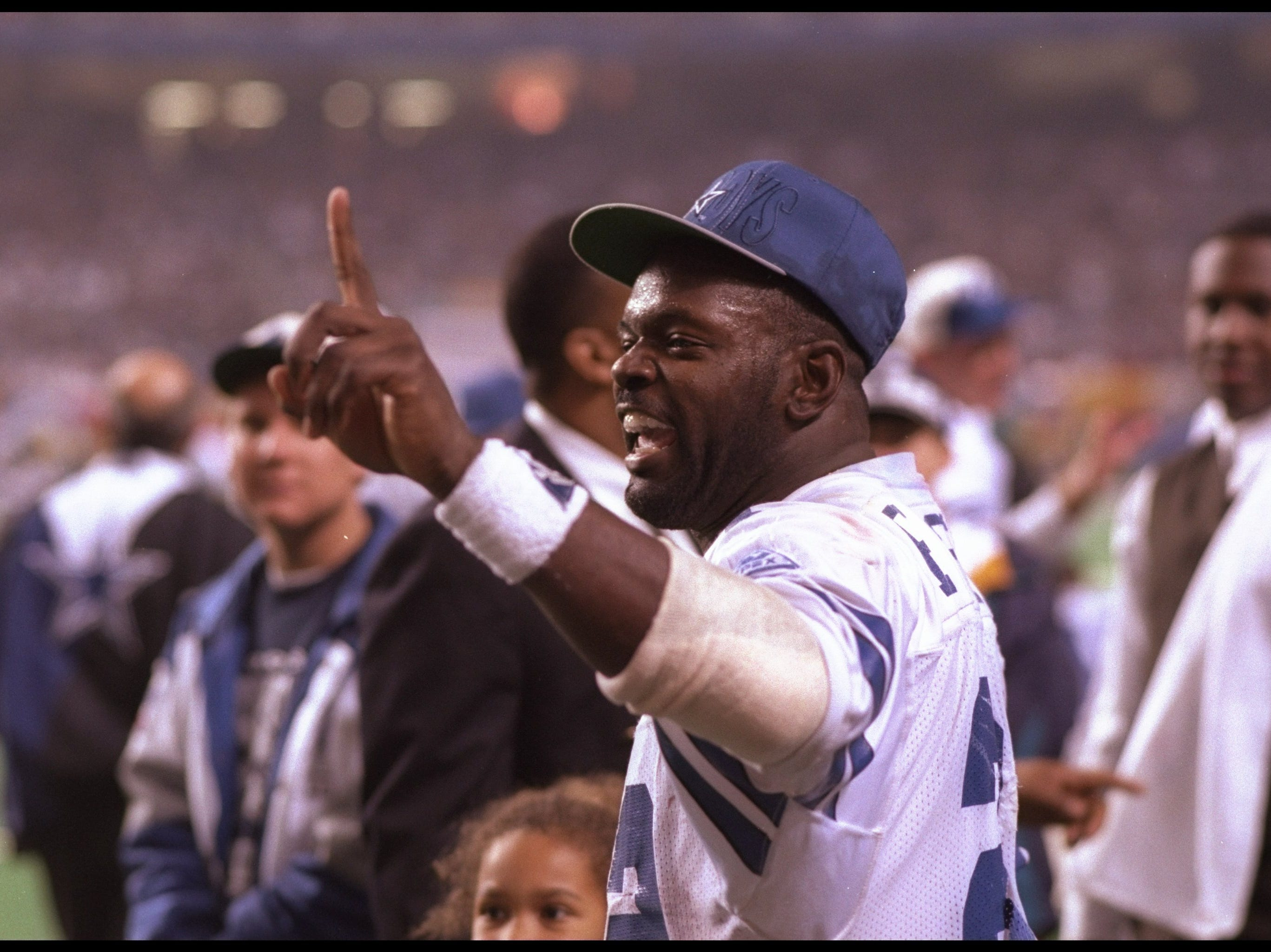 31 Jan 1993: Running back Emmitt Smith of the Dallas Cowboys celebrates during Super Bowl XXVII against the Buffalo Bills at the Rose Bowl in Pasadena, California. The Cowboys won the game, 52-17.