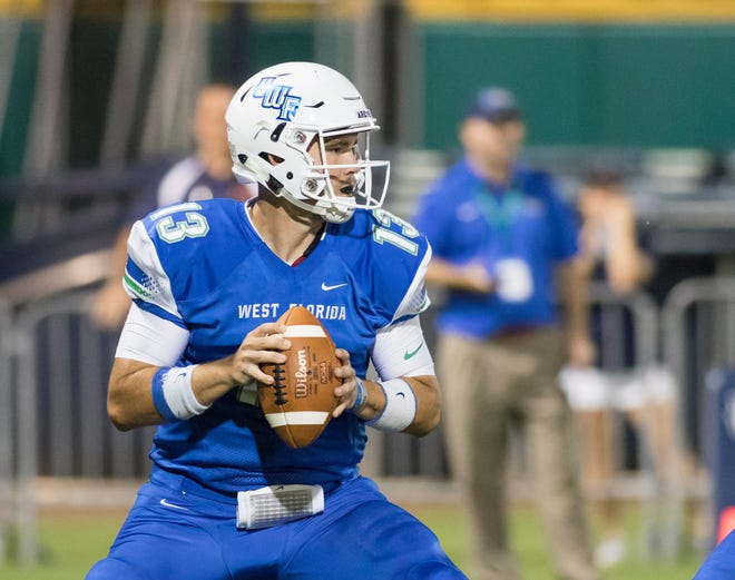 Quarterback Mike Beaudry (13) looks for an open receiver during the Carson-Newman vs University of West Florida football game at Blue Wahoos stadium in Pensacola on Thursday, August 30, 2018.