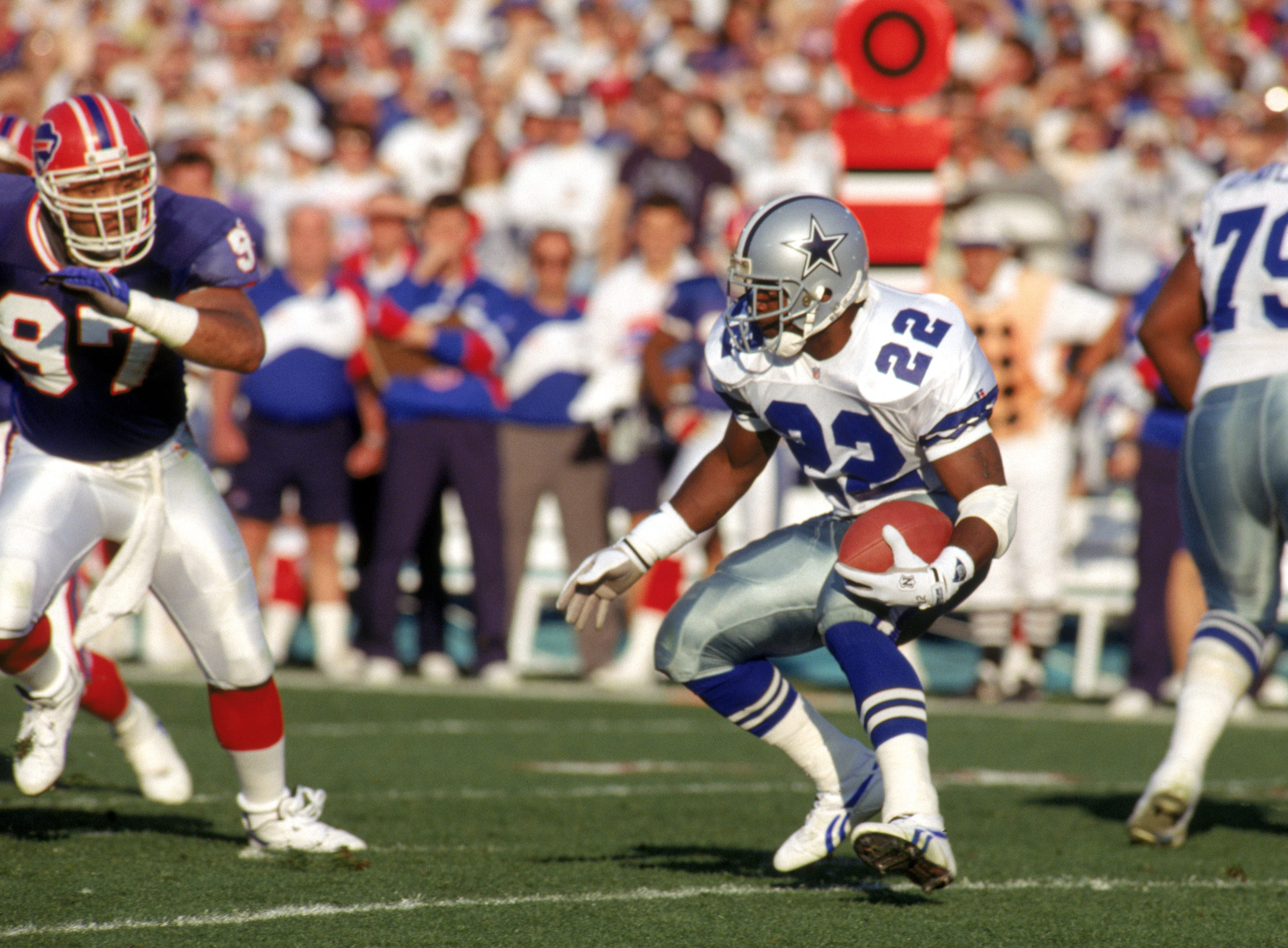 PASADENA, CA - JANUARY 31:  Running back Emmitt Smith #22 of the Dallas Cowboys rushes for yards during Super Bowl XXVII against the Buffalo Bills at the Rose Bowl on January 31, 1993 in Pasadena, California.  The Cowboys won 52-17.  (Photo by George Rose/Getty Images)