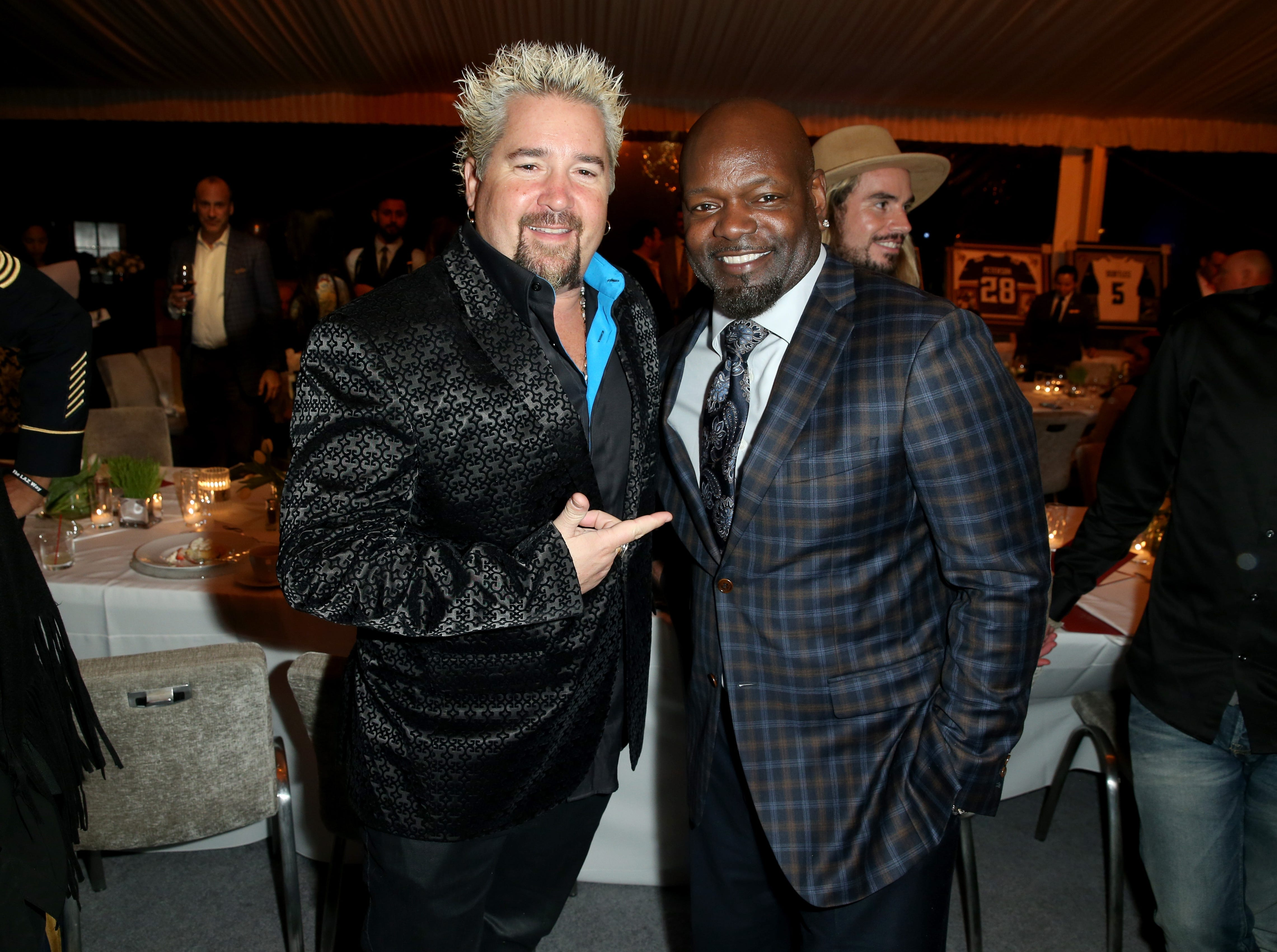 SAN FRANCISCO, CA - FEBRUARY 04:  Chef Guy Fieri (L) and former NFL player Emmitt Smith attend Haute Living And Louis XIII Celebrate Jim Brown's 80th Birthday on February 4, 2016 in San Francisco, California.  (Photo by Joe Scarnici/Getty Images for Haute Living)