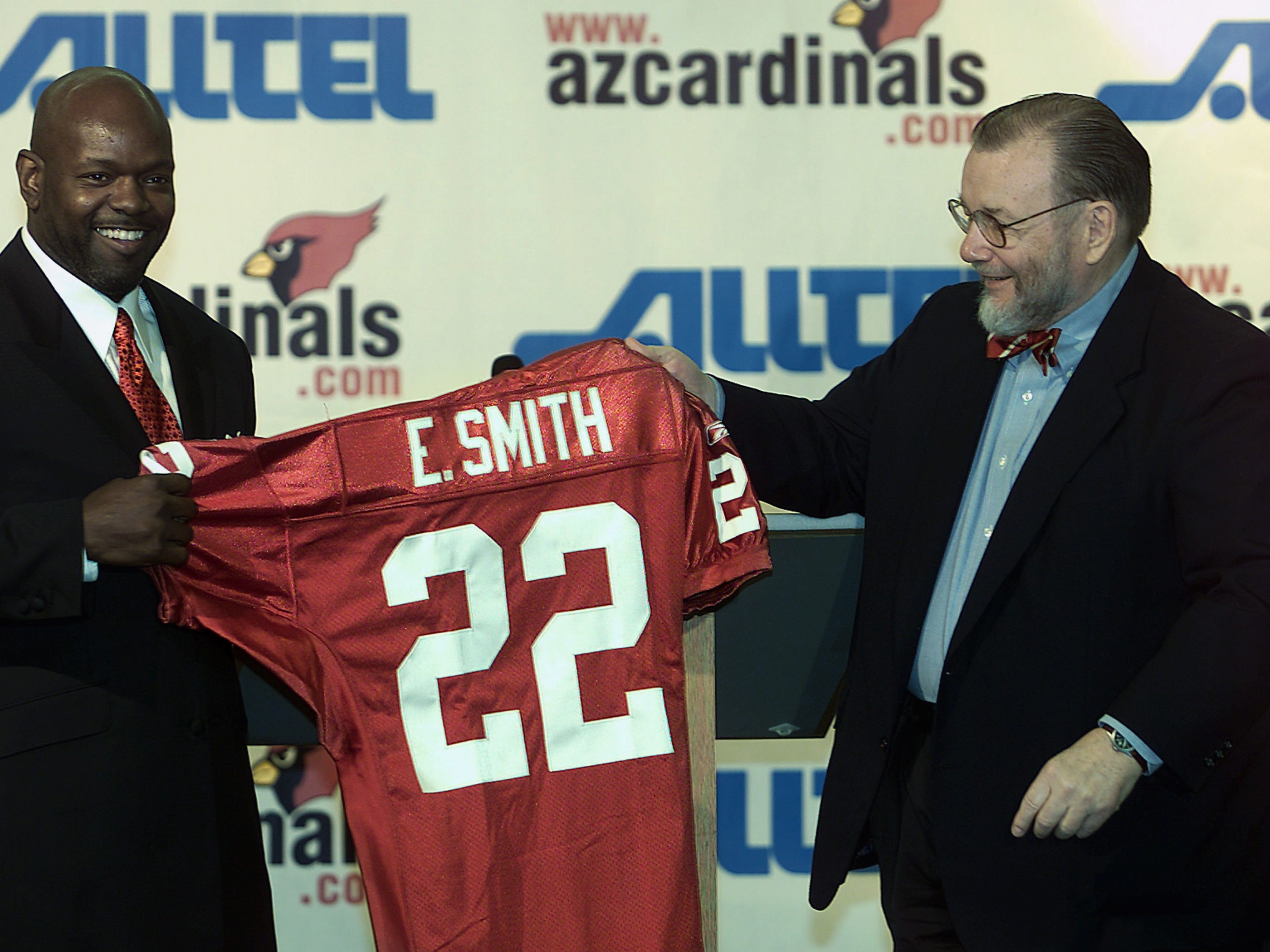 Emmit Smith poses with his jersey after signing with the Arizona Cardinals.