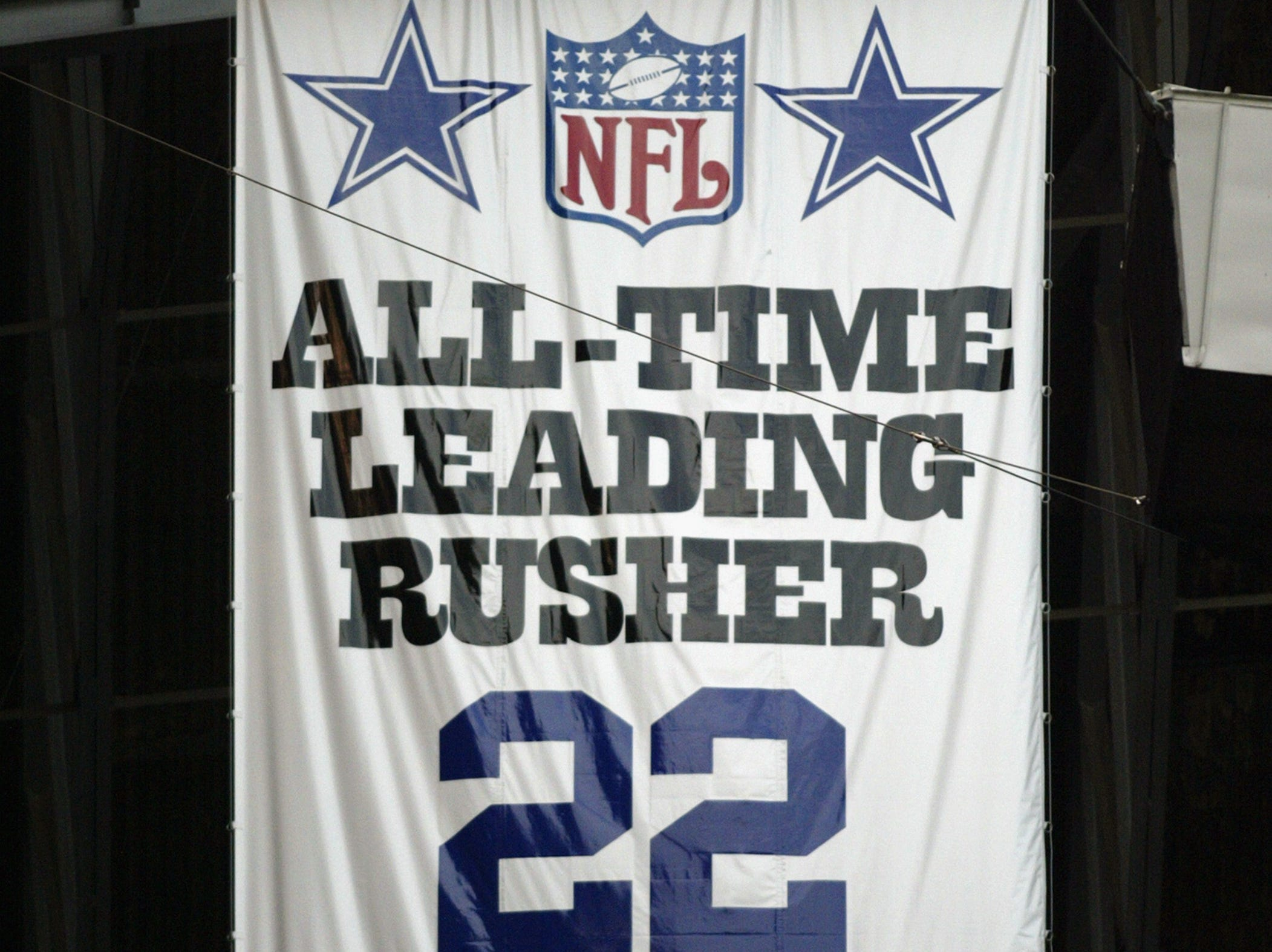 IRVING, TX - NOVEMBER 24:  A banner hangs from Texas Stadium rafters in tribute to Emmitt Smith #22 of the Dallas Cowboys as the all-time leading rusher, during the NFL game against the Jacksonville Jaguars at Texas Stadium on November 24, 2002 in Irving, Texas.  The Jaguars defeated the Cowboys 21-19.  (Photo by Ronald Martinez/Getty Images)
