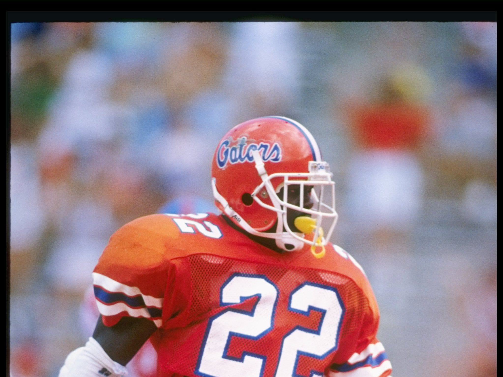 Running back Emmitt Smith of the Florida Gators walks down the field during a game against the Mississippi Rebels at Florida Field in Gainesville, Florida.  Mississippi won the game 24-19. Mandatory Credit: Allen Dean Steele  /Allsport