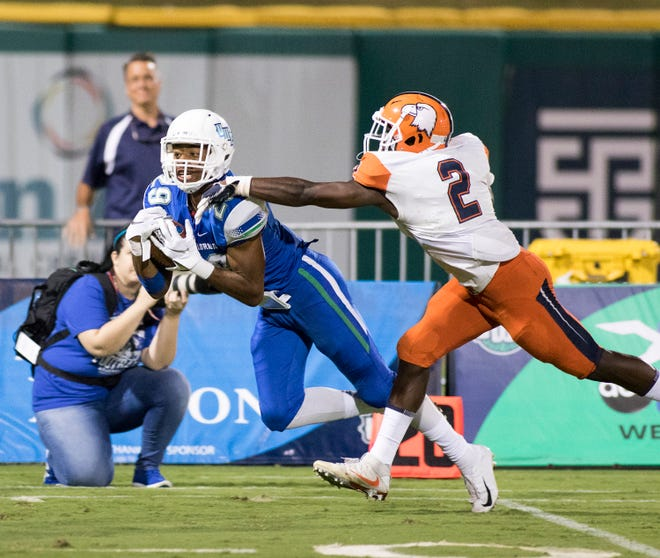 Wide receiver Quentin Randolph (29), of Navarre, catches a long pass during the Carson-Newman vs University of West Florida football game at Blue Wahoos stadium in Pensacola on Thursday, August 30, 2018.