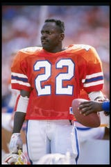 14 Oct 1989:  Running back Emmitt Smith of the Florida Gators stands on the sidelines during a game against the Vanderbilt Commadores at Florida Field in Gainesville, Florida.  Florida won the game 34-11. Mandatory Credit: Allen Dean Steele  /Allsport