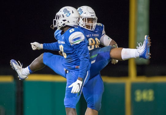 Jefferson Vea (8) and  Andrew Wilcox (96)  celebrate after sacking Eagles quarterback Derrick Evans (14) during the Carson-Newman vs University of West Florida football game at Blue Wahoos stadium in Pensacola on Thursday, August 30, 2018.