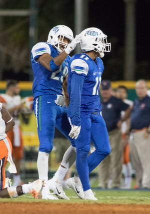 Quentin Randolph (29) congratulates fellow wide receiver Ishmel Morrow (11) after a great play during the Carson-Newman vs University of West Florida football game at Blue Wahoos stadium in Pensacola on Thursday, August 30, 2018.