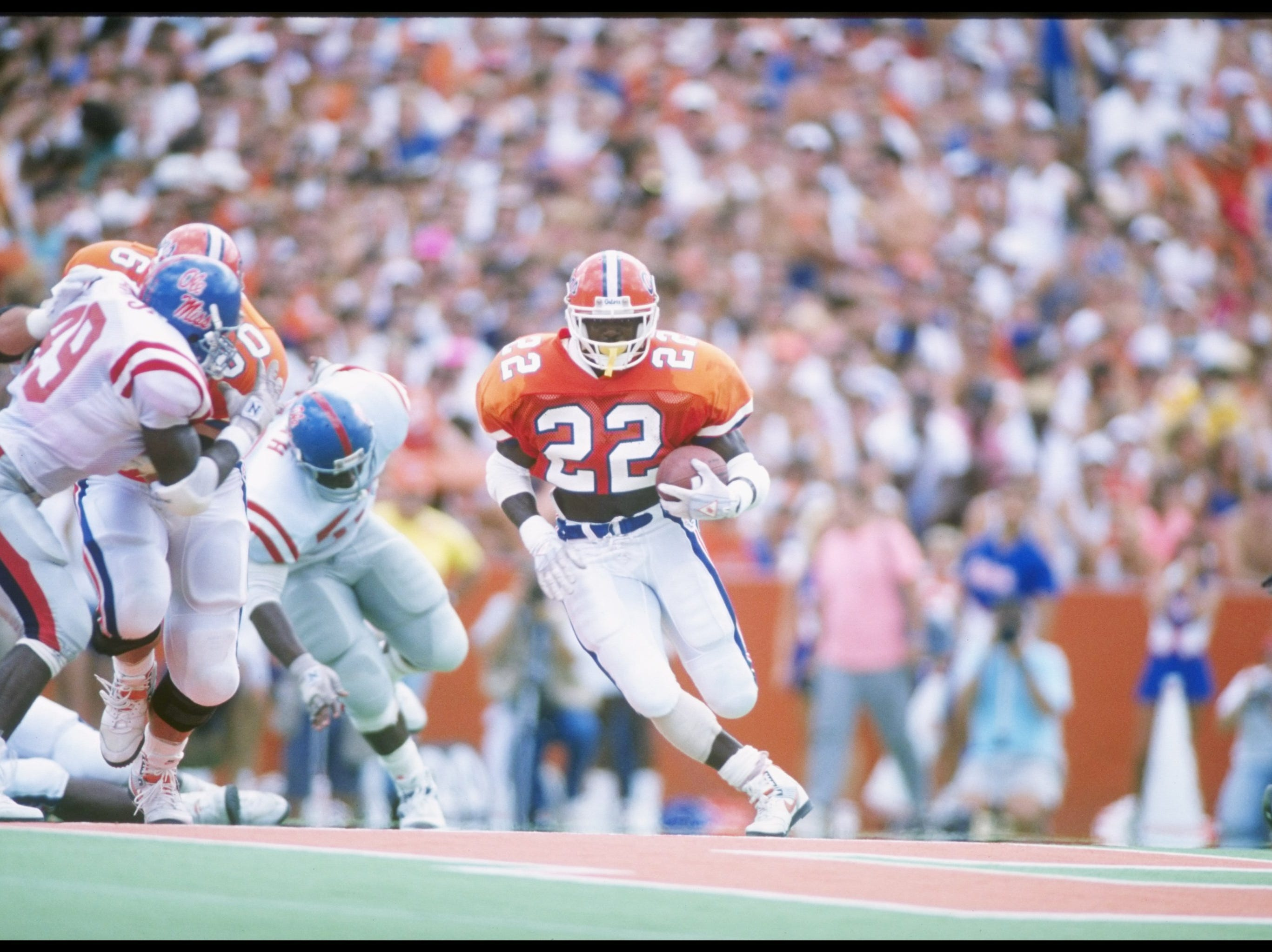 Running back Emmitt Smith of the Florida Gators runs down the field during a game against the Mississippi Rebels at Florida Field in Gainesville, Florida.  Mississippi won the game 24-19. Mandatory Credit: Allen Dean Steele  /Allsport