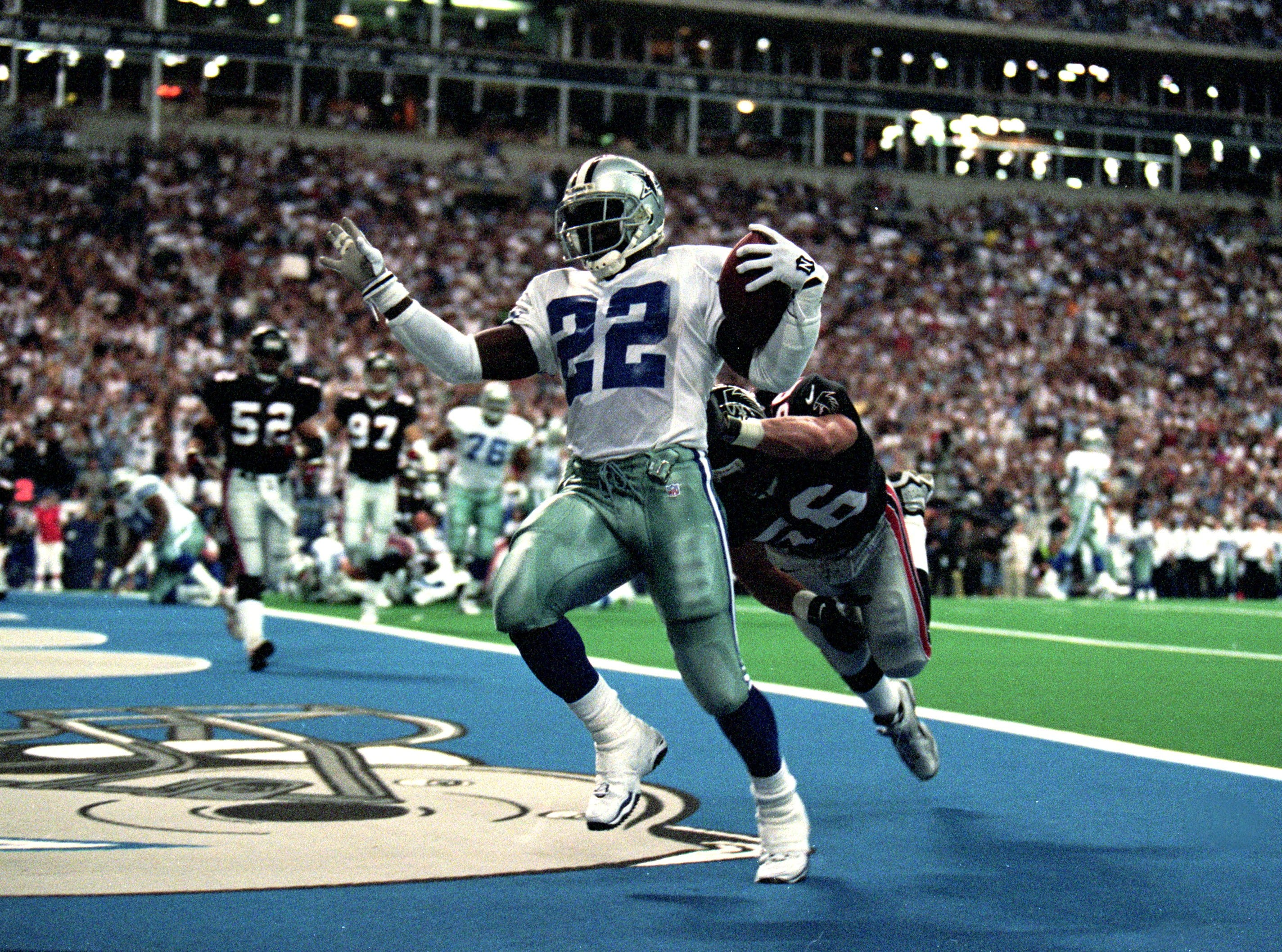 20 Sep 1999: Emmitt Smith #22 of the Dallas Cowboys makes a touchdown as he is hit by Mike Brookings #56 of the Atlanta Falcons at the Texas Stadium in Irving, Texas. The Cowboys defeated the Falsons 24-7. Mandatory Credit: Brian Bahr  /Allsport