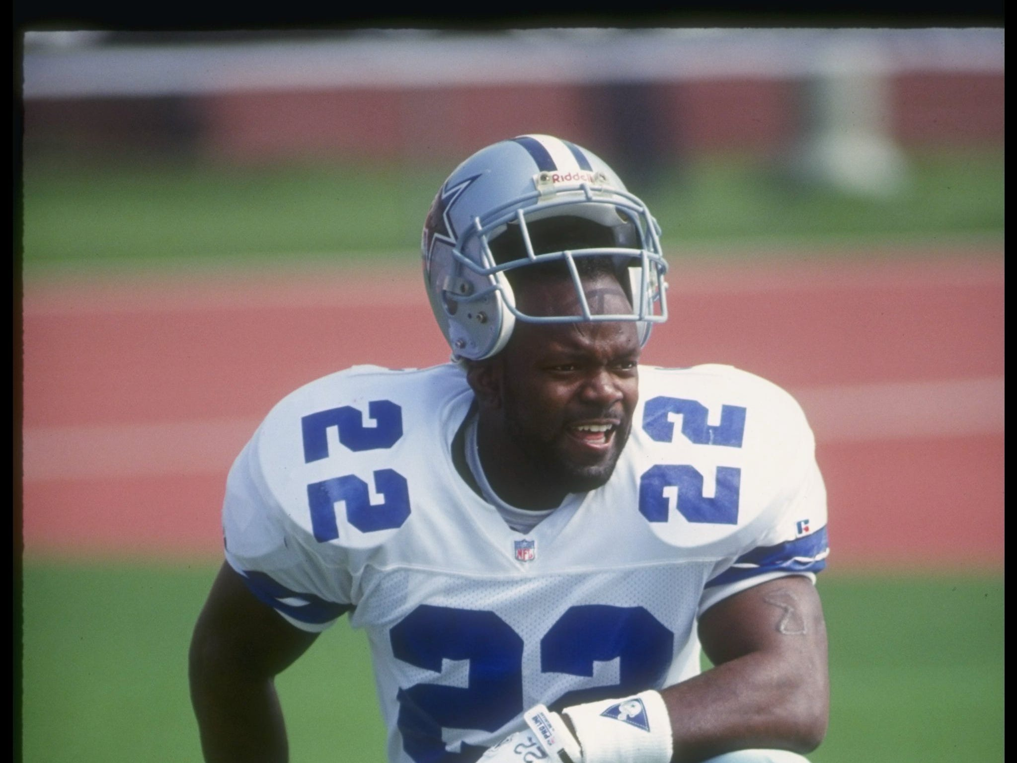 Running back Emmitt Smith of the Dallas Cowboys looks on during a game against the Los Angeles Raiders at the Coliseum in Los Angeles, California.  The Cowboys won the game, 28-13. Mandatory Credit: Markus Boesch  /Allsport