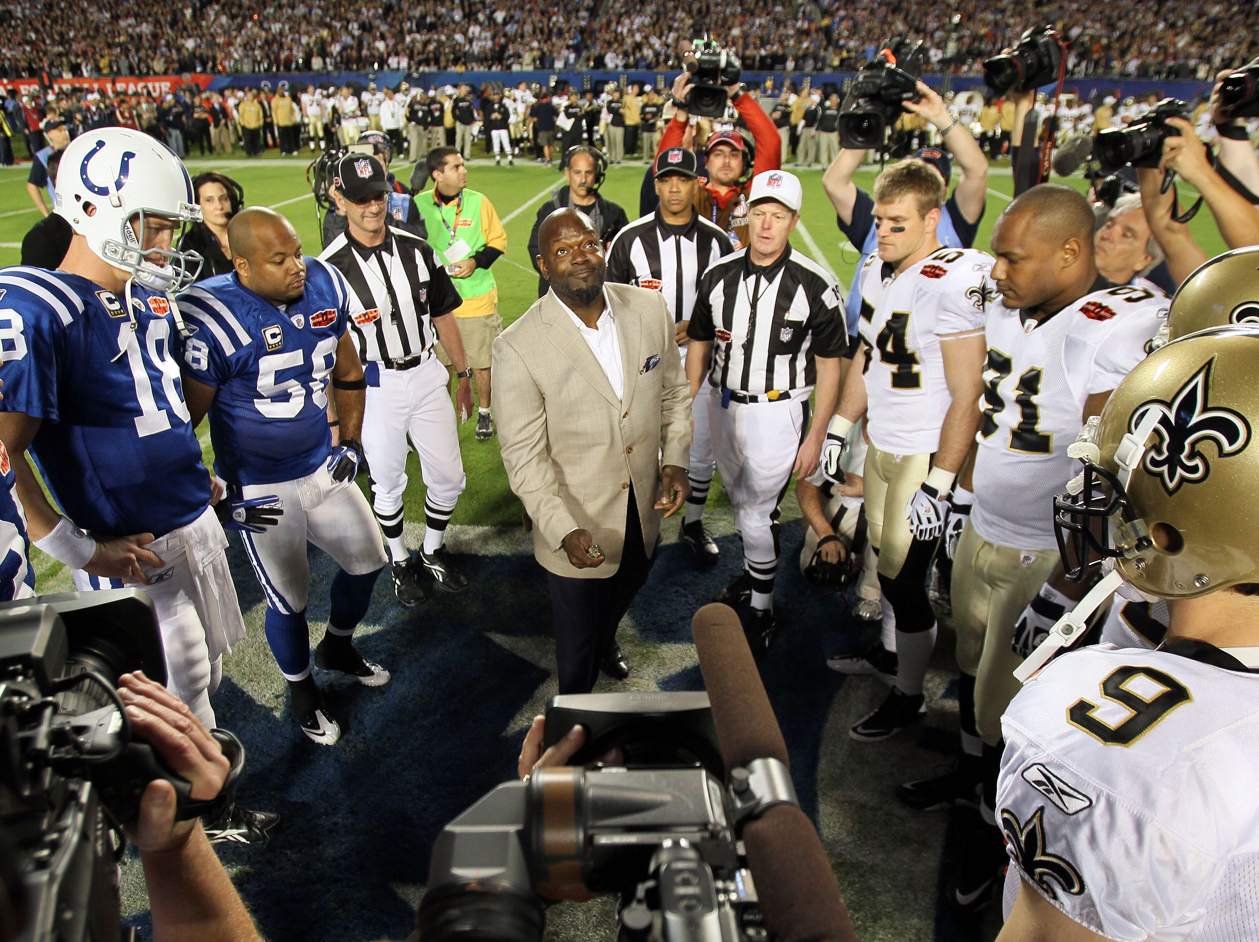MIAMI GARDENS, FL - FEBRUARY 07: NFL Hall of Famer Emmitt Smith flips the coin prior to the start of Super Bowl XLIV between the Indianapolis Colts and the New Orleans Saints on February 7, 2010 at Sun Life Stadium in Miami Gardens, Florida.  (Photo by Andy Lyons/Getty Images)