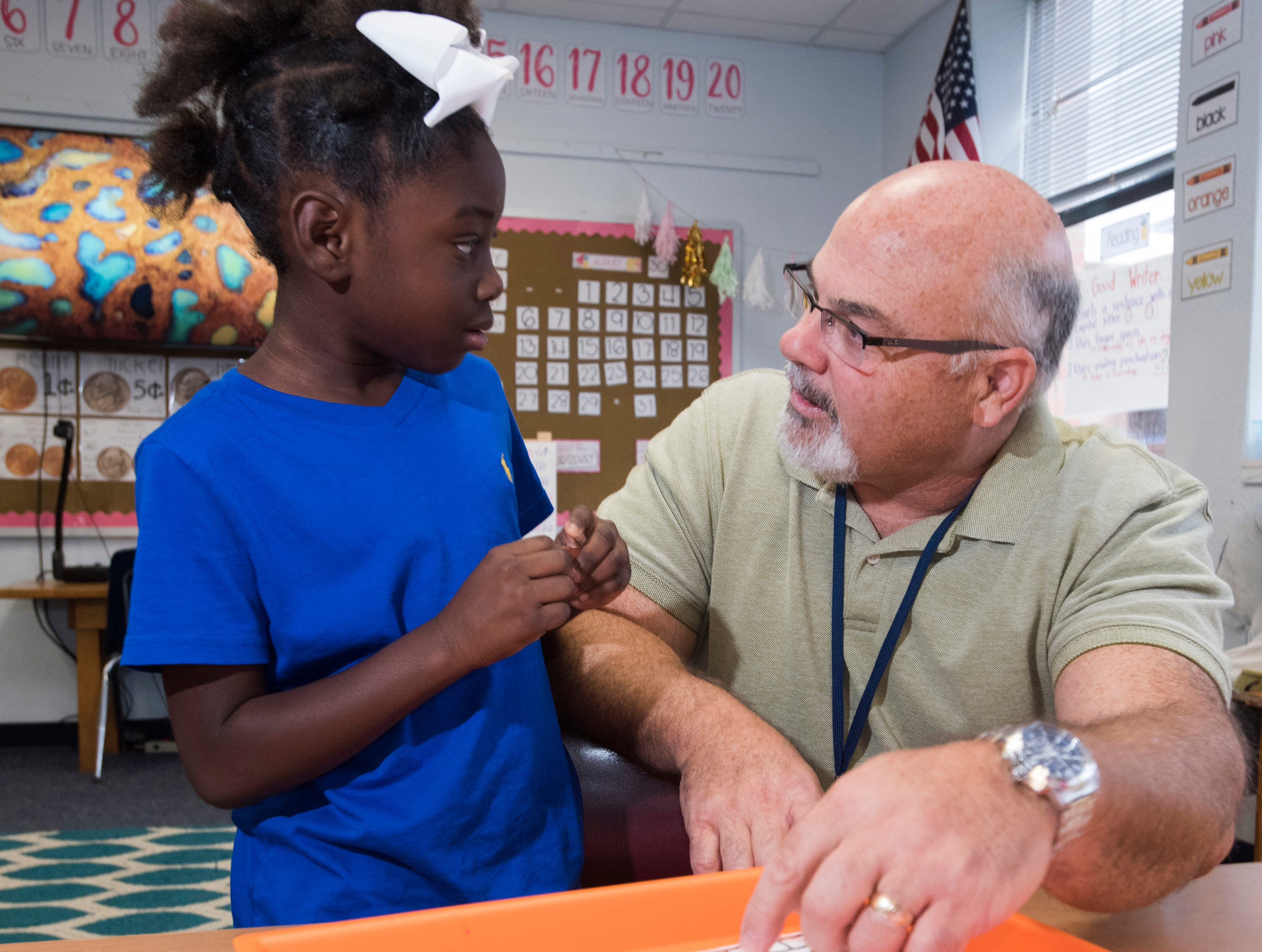 Warrington Elementary School's new principal once served in the U.S. Marine Corps