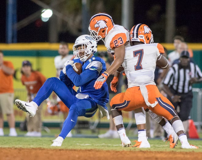 Wide receiver Ishmel Morrow (11) hangs on the ball as he goes to the ground during the Carson-Newman vs University of West Florida football game at Blue Wahoos stadium in Pensacola on Thursday, August 30, 2018.