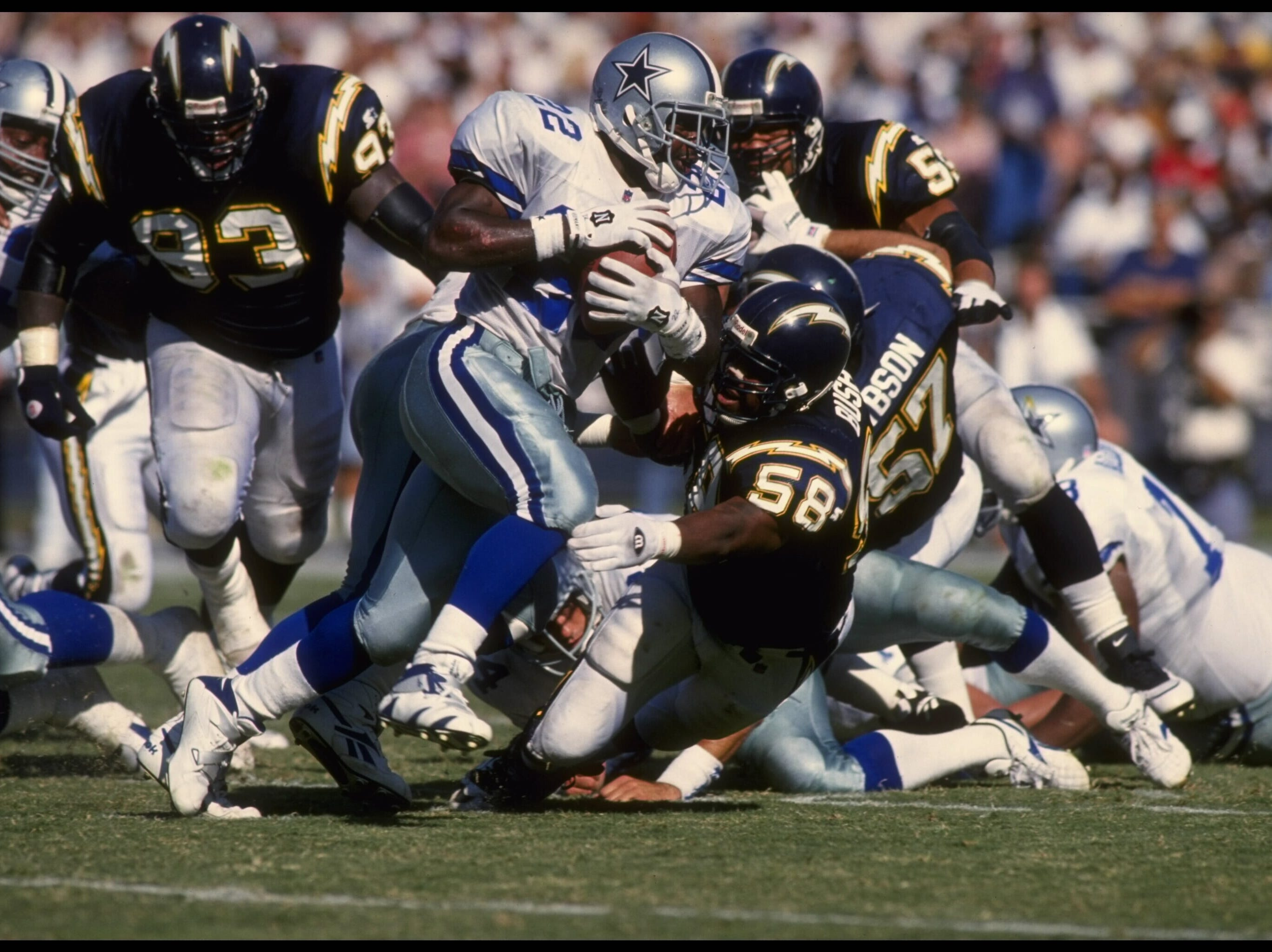 LINEBACKER LEWIS BUSH #58 OF THE SAN DIEGO CHARGERS STRETCHES OUT TO TACKLE RUNNING BACK EMMITT SMITH #22 OF THE DALLAS COWBOYS DURING THE COWBOYS 23-9 WIN AT JACK MURPHY STADIUM IN SAN DIEGO, CALIFORNIA.  MANDATORY CREDIT:  STEPHEN DUNN/ALL