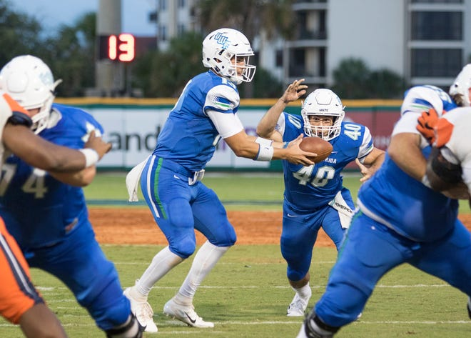 Quarterback Mike Beaudry (13) hands off to Chris Schwarz (40) during the Carson-Newman vs University of West Florida football game at Blue Wahoos stadium in Pensacola on Thursday, August 30, 2018.