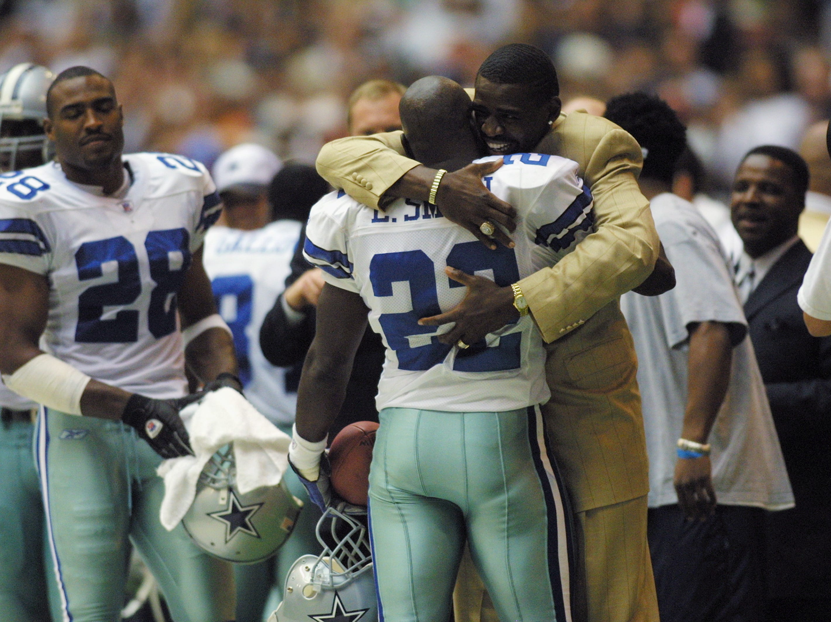 "Running Back Emmitt Smith #22 of the Dallas Cowboys is congratulated for being the ""All Time Lead Rusher"" in the NFL during the NFL game against the Seattle Seahawks at Texas Stadium on October 27, 2002 in Irving, Texas. The Seahawks defeated the Cowboys 17-14. (Photo by Ronald Martinez/Getty Images)"