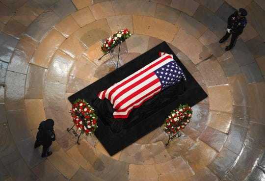 The body of Sen. John McCain lay in state in Capitol Rotunda on Friday. Photo by Jack Gruber, USA TODAY Staff