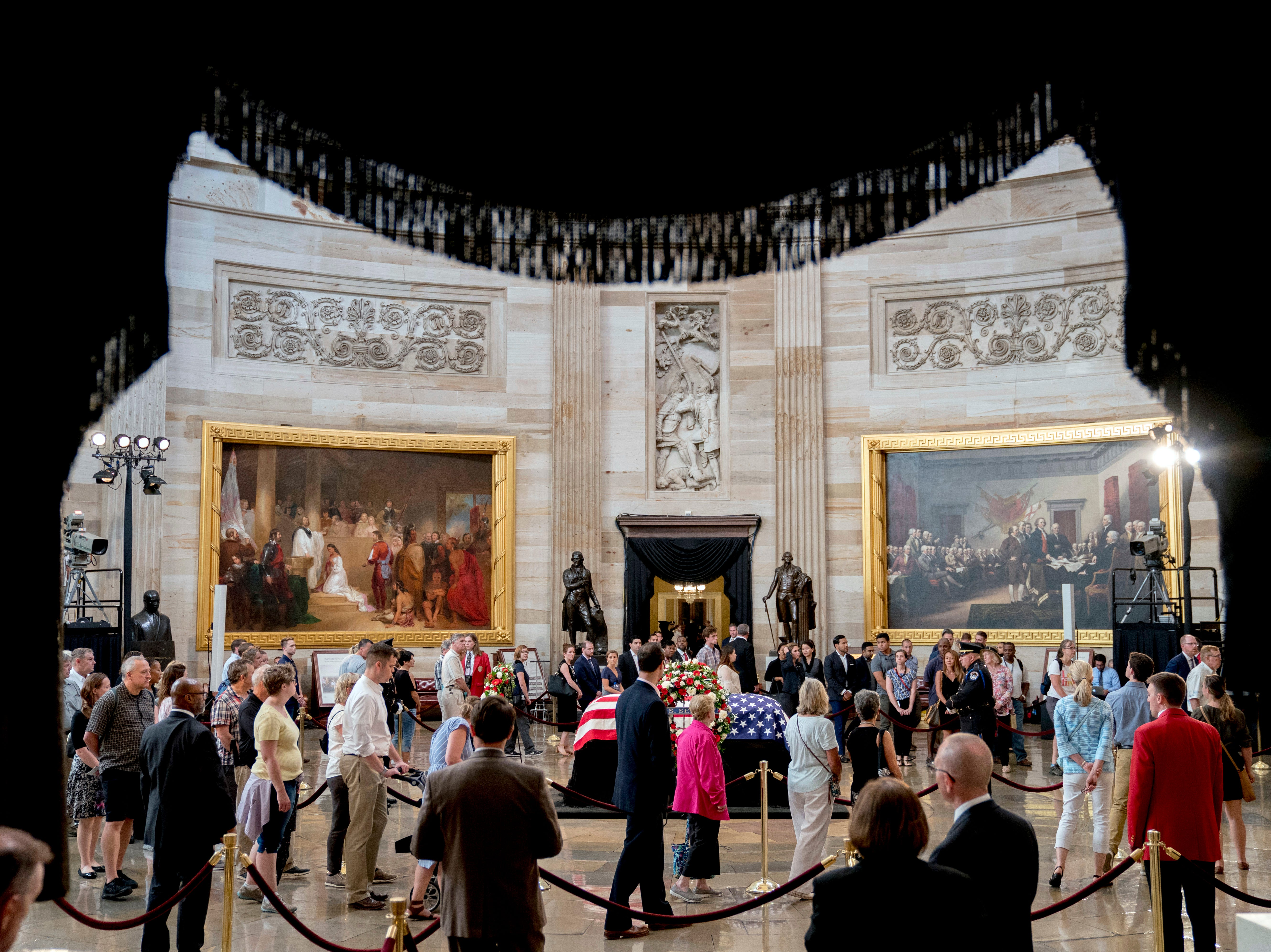 Members of the public come to pay their respects as Sen. John McCain, R-Ariz., lies in state in the Rotunda of the U.S. Capitol, Friday, Aug. 31, 2018, in Washington. (AP Photo/Andrew Harnik)