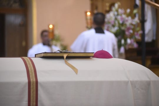 A close-up of the casket holding the body of retired Phoenix Bishop Thomas J. O'Brien during his funeral mass at St. Mary's Basilica in downtown Phoenix on Aug. 31, 2018.