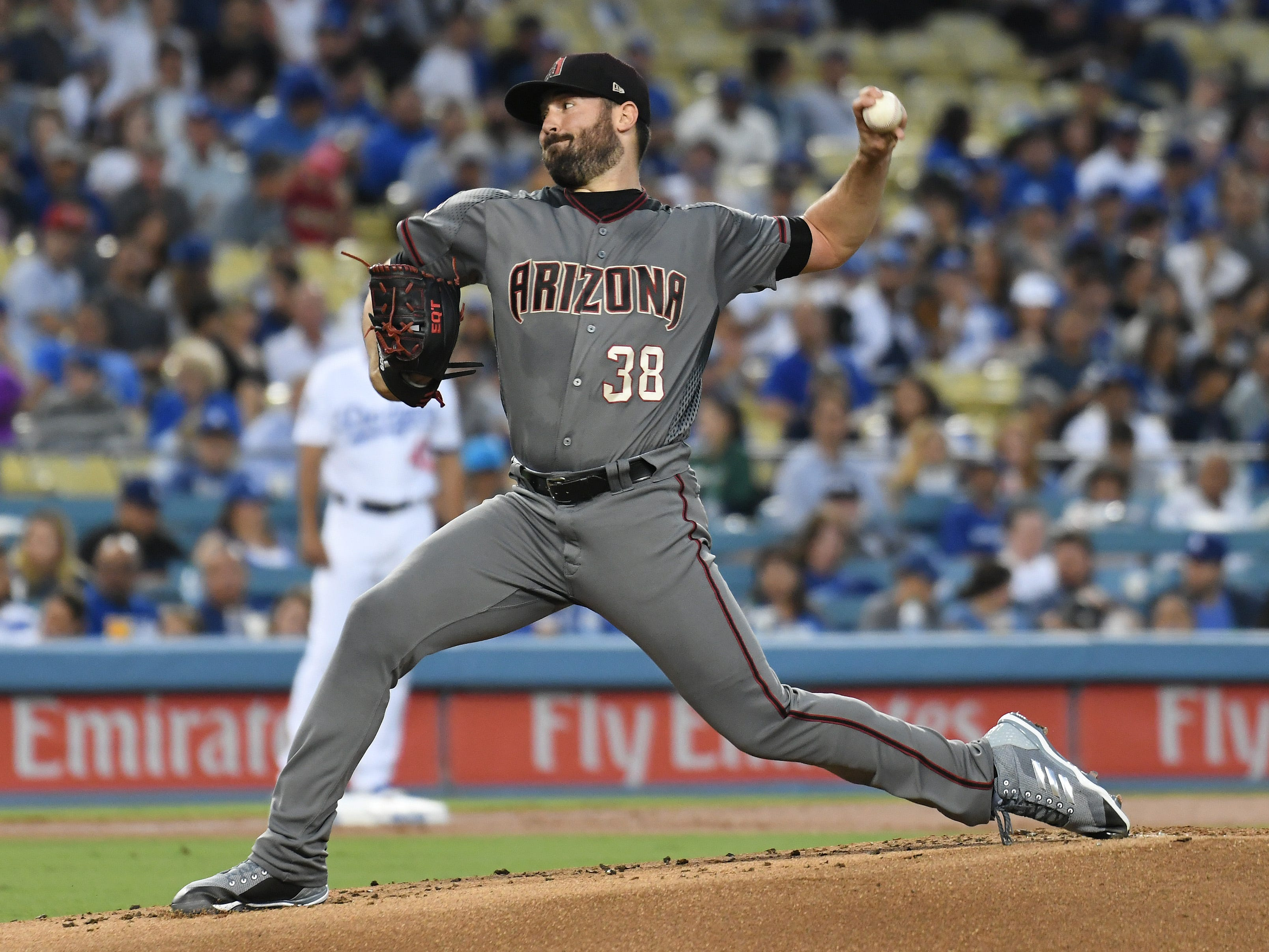 Aug 30, 2018; Los Angeles, CA, USA; Arizona Diamondbacks starting pitcher Robbie Ray (38) pitches against the Los Angeles Dodgers in the first inning at Dodger Stadium. Mandatory Credit: Richard Mackson-USA TODAY Sports