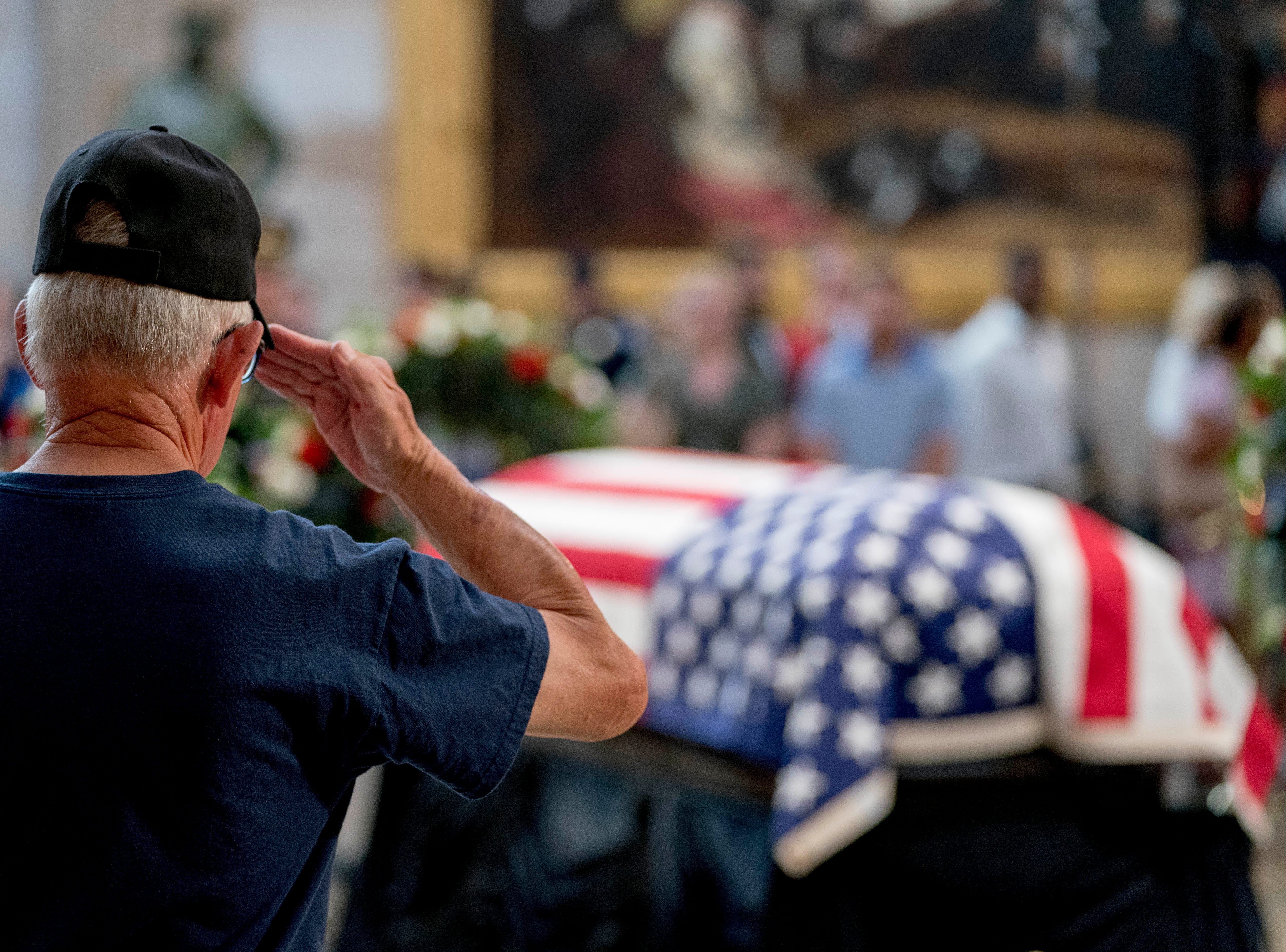 A Vietnam War veteran salutes the casket of Sen. John McCain, R-Ariz., in the Rotunda of the U.S. Capitol, Friday, Aug. 31, 2018, in Washington. (AP Photo/Andrew Harnik)