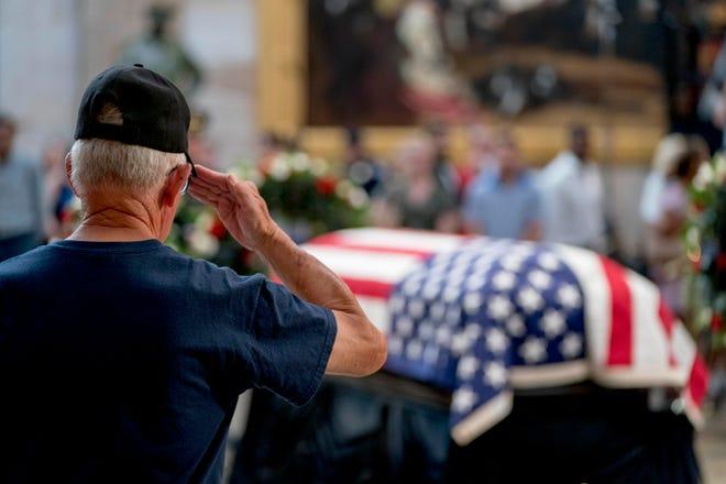 A Vietnam War veteran salutes the casket of Sen. John McCain, R-Ariz., in the Rotunda of the U.S. Capitol, Friday, Aug. 31, 2018, in Washington. (AP Photo/Andrew Harnik)