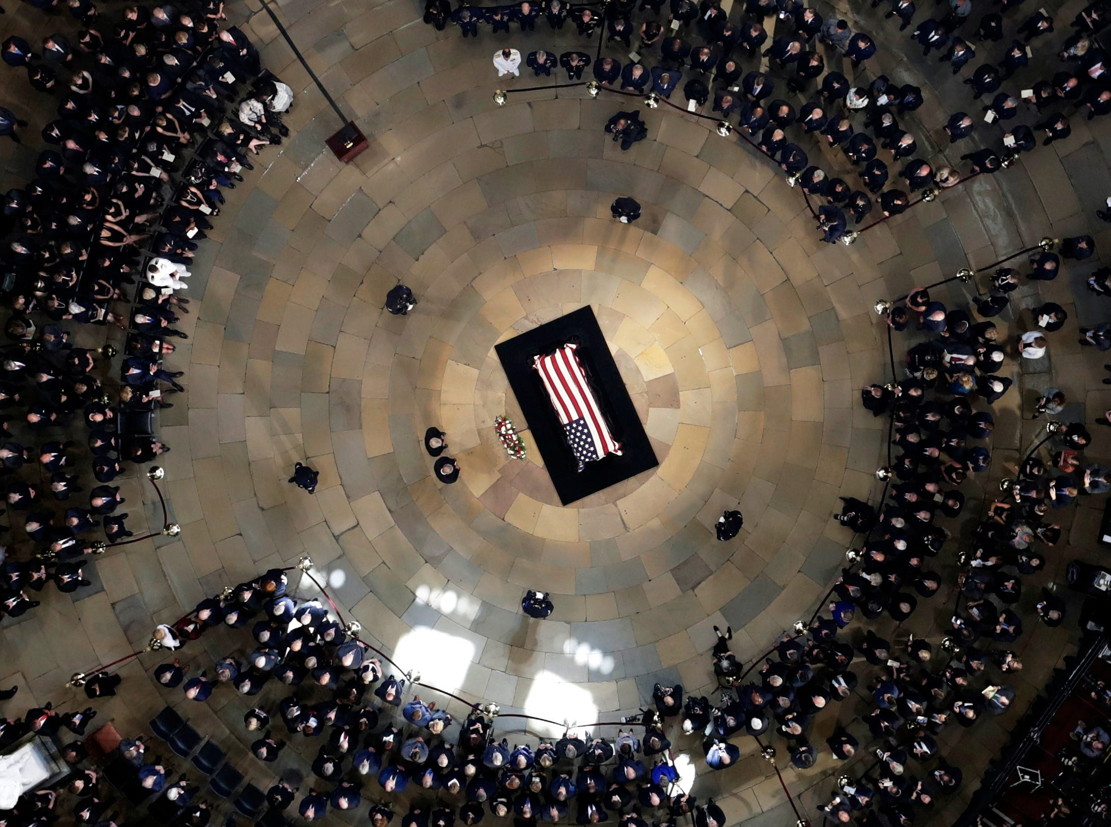 Senate leaders Mitch McConnell and Chuck Schumer stand near the casket as Sen. John McCain, R-Ariz., lies in state in the U.S. Capitol rotunda Aug. 31, 2018, in Washington.