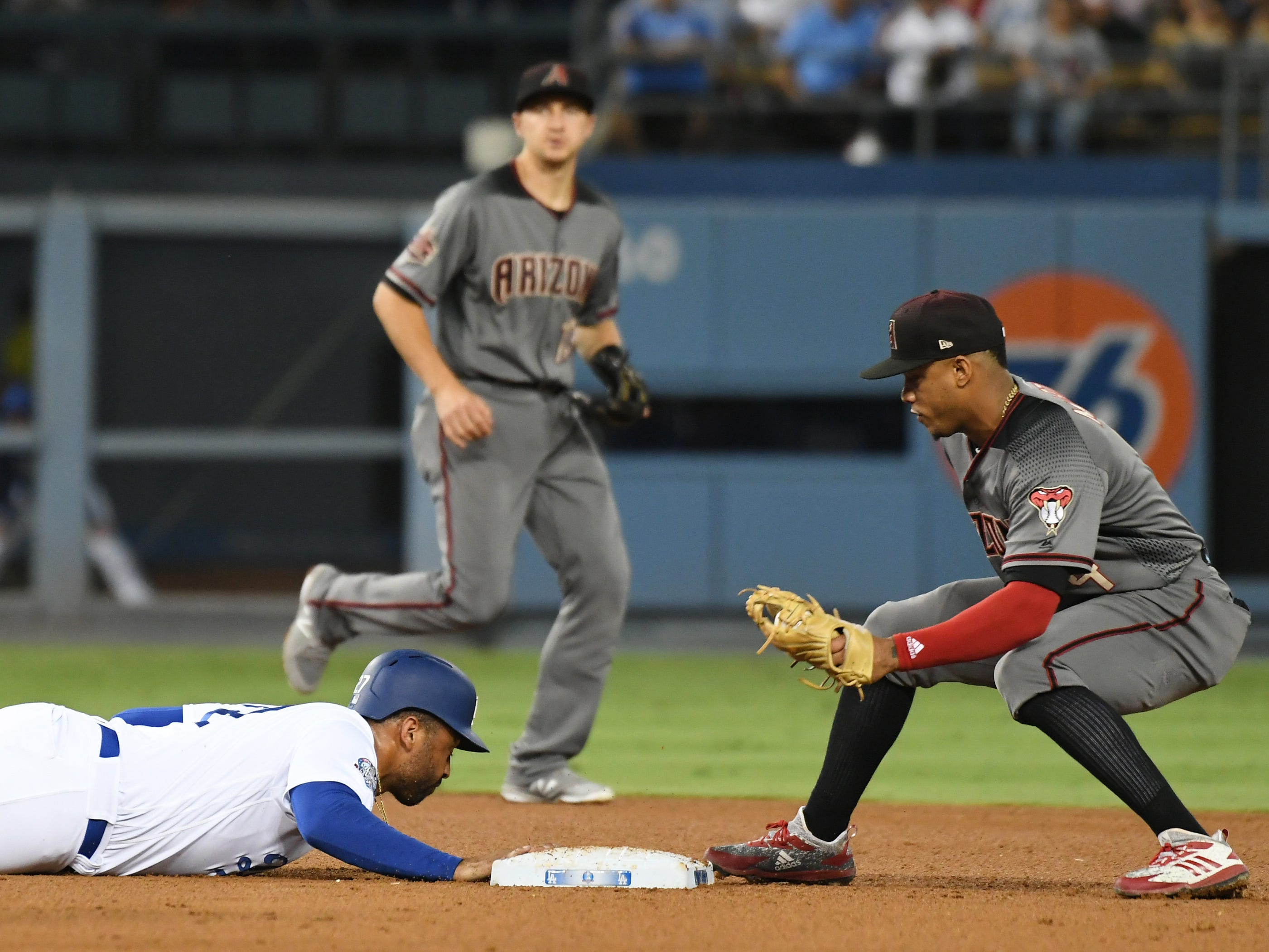 Aug 30, 2018; Los Angeles, CA, USA; Los Angeles Dodgers left fielder Matt Kemp (27) dives back to second against Arizona Diamondbacks shortstop Ketel Marte (4) in the fourth inning at Dodger Stadium. Mandatory Credit: Richard Mackson-USA TODAY Sports