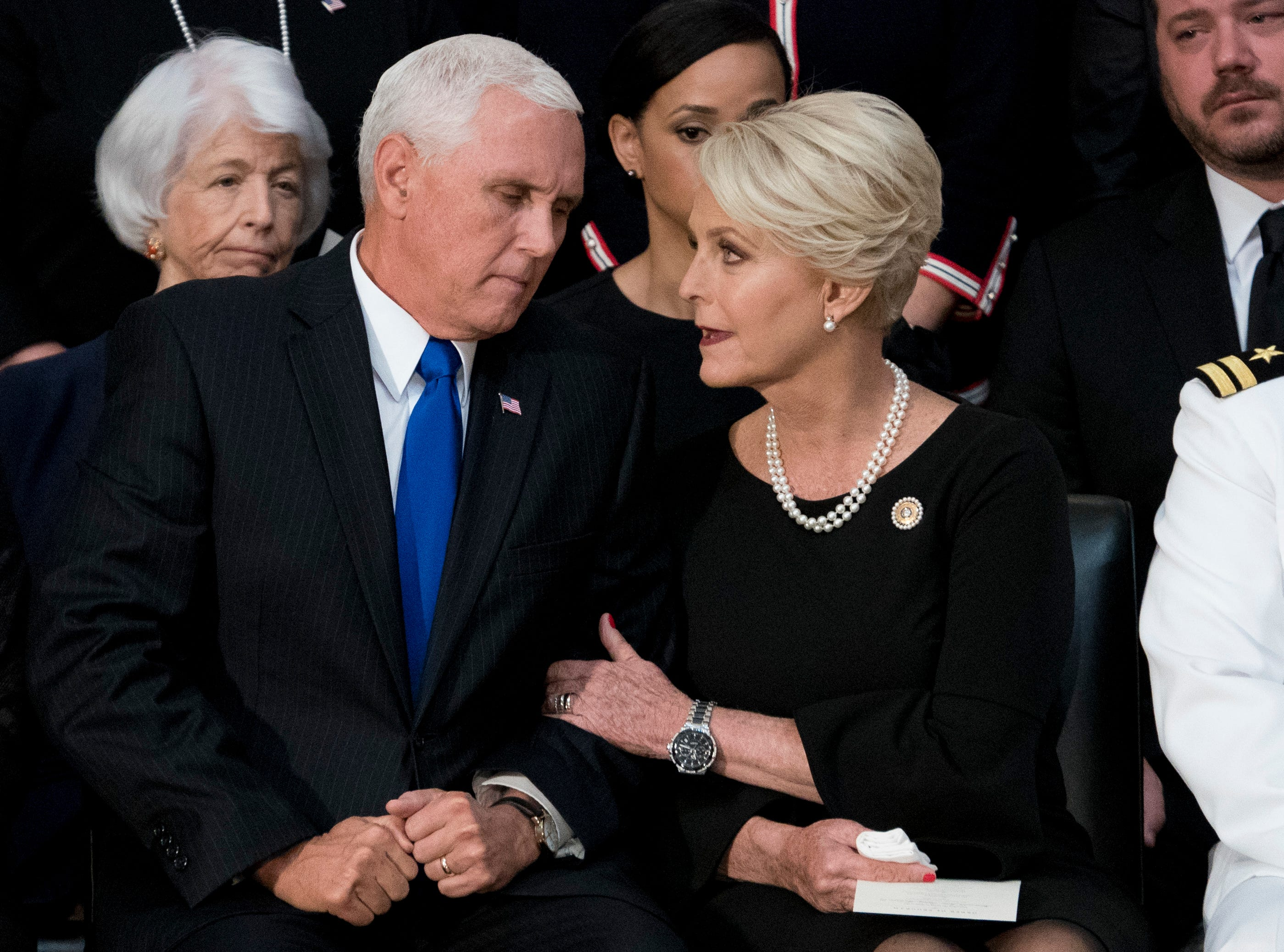 Cindy McCain, wife of Sen. John McCain, R-Ariz., right, talks with Vice President Mike Pence, left, after he speaks at a ceremony for John McCain as he lies in state in the Rotunda of the U.S. Capitol, Friday, Aug. 31, 2018, in Washington. (AP Photo/Andrew Harnik, Pool)