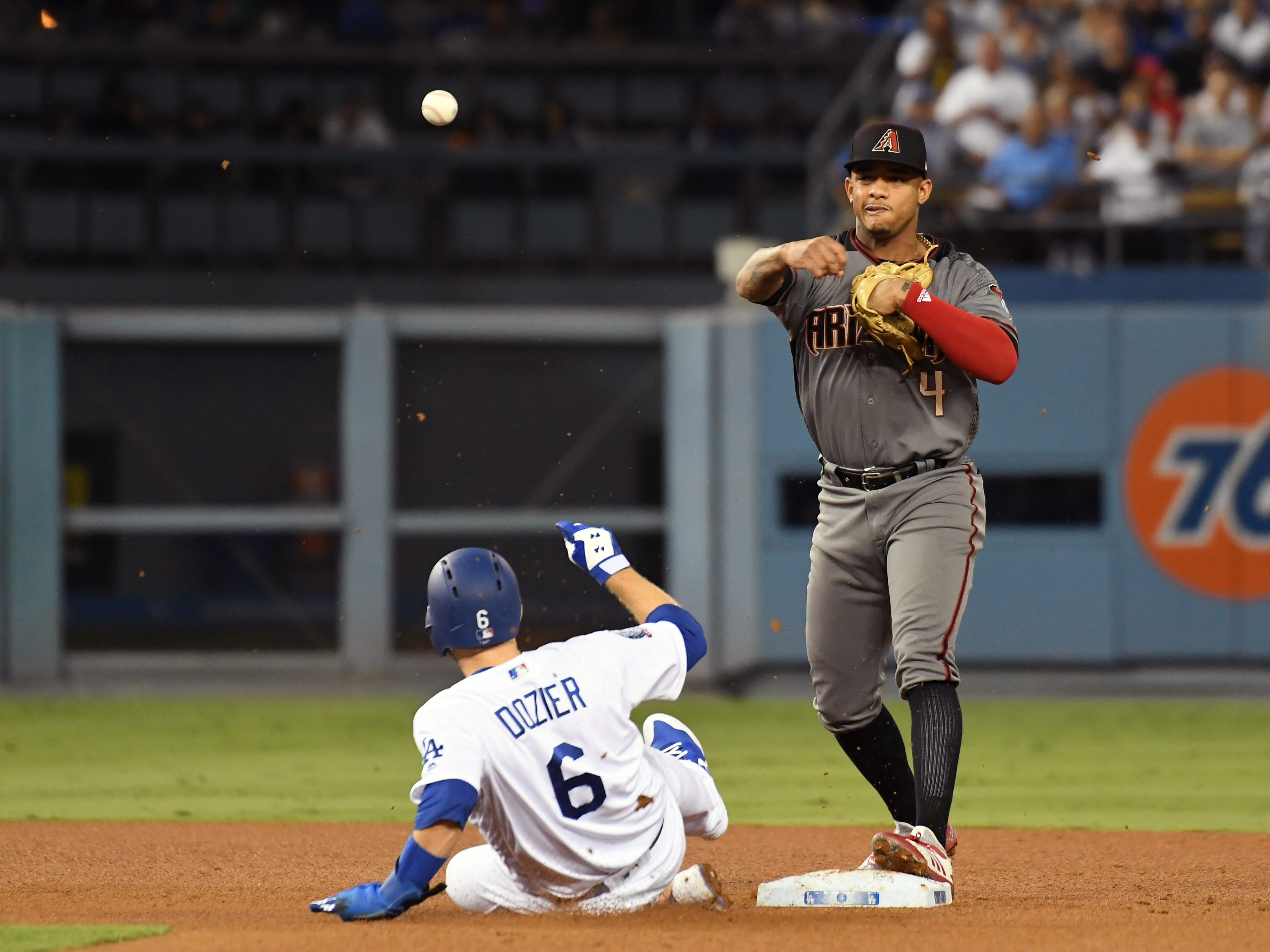 Aug 30, 2018; Los Angeles, CA, USA; Los Angeles Dodgers second baseman Brian Dozier (6) is out against Arizona Diamondbacks shortstop Ketel Marte (4) at second on a double play in the third inning at Dodger Stadium. Mandatory Credit: Richard Mackson-USA TODAY Sports