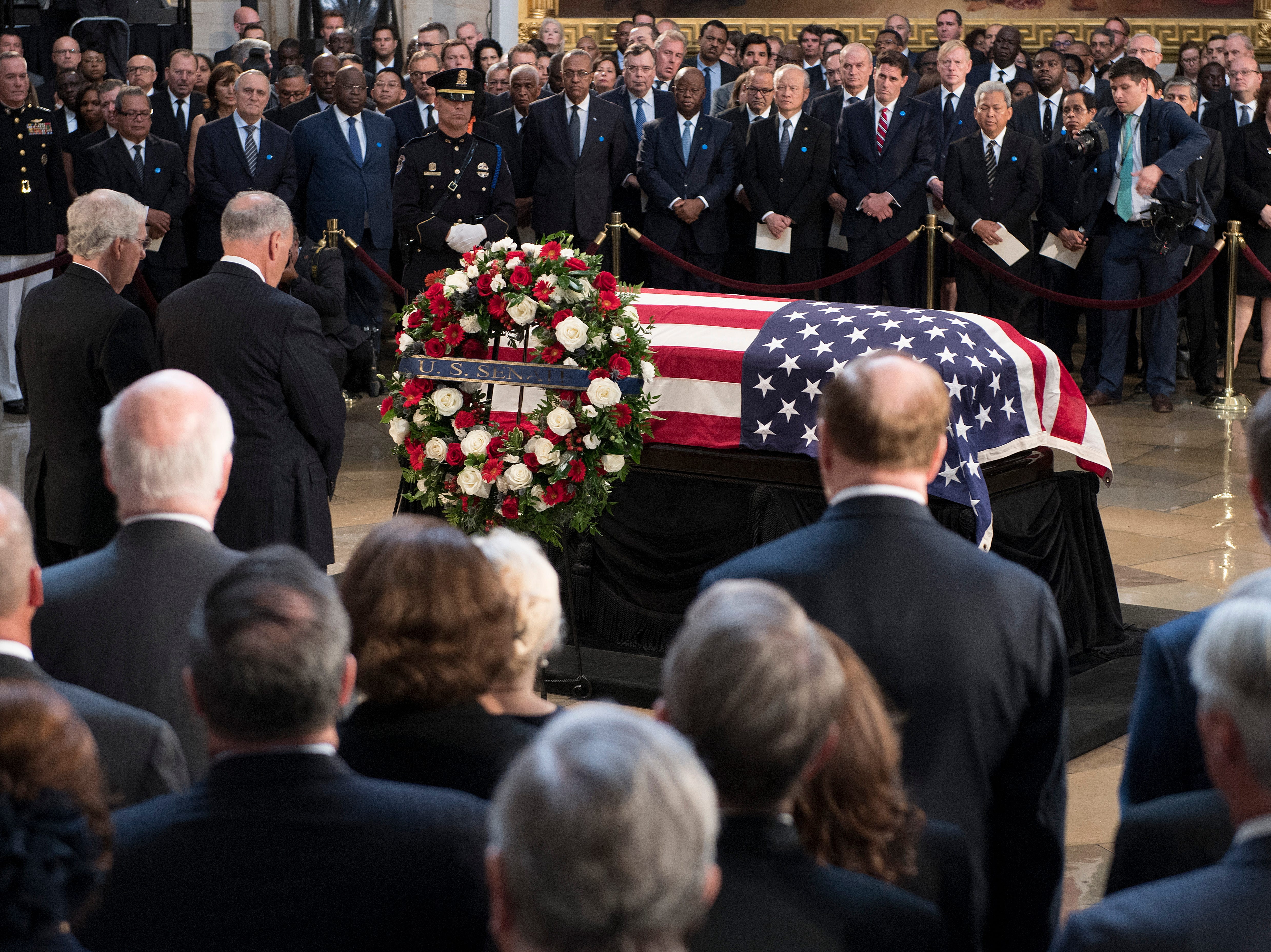 Senate Majority Leader Mitch McConnell, left, and Senate Minority Leader Chuck Schumer, pay their respects the the flag-draped coffin holding the remains of Sen. John McCain, R-Ariz., in the U.S. Capitol, Friday, Aug. 31, 2018 in Washington. (Jim Watson/Pool photo via AP)