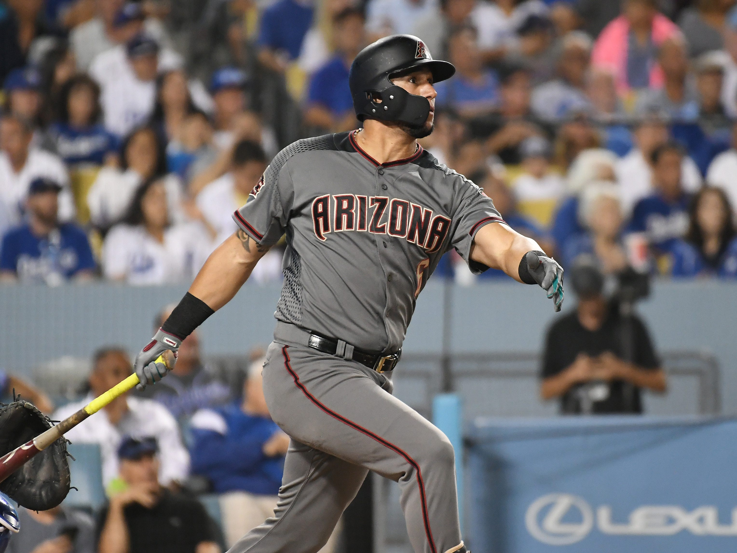 Aug 30, 2018; Los Angeles, CA, USA; Arizona Diamondbacks right fielder David Peralta (6) hits a three run home run against the Los Angeles Dodgers in the fifth inning at Dodger Stadium. Mandatory Credit: Richard Mackson-USA TODAY Sports