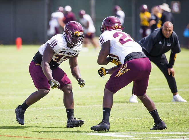 Arizona State University defensive back Joey Bryant, left, rushes linebacker Kaylan Kearse-Thomas, right, at practice in Tempe, Tuesday, August 21, 2018.