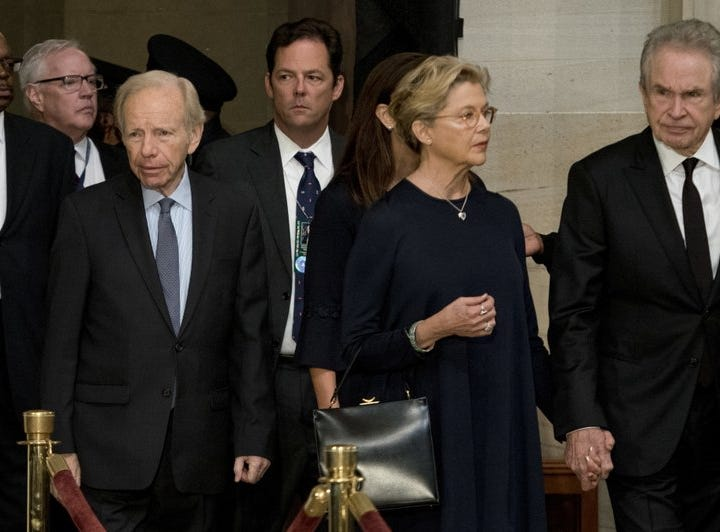 Former Connecticut Sen. Joe Lieberman (from left) and actors Annette Benning and Warren Beatty arrive in the rotunda at the U.S. Capitol in Washington on Aug. 31, 2018.