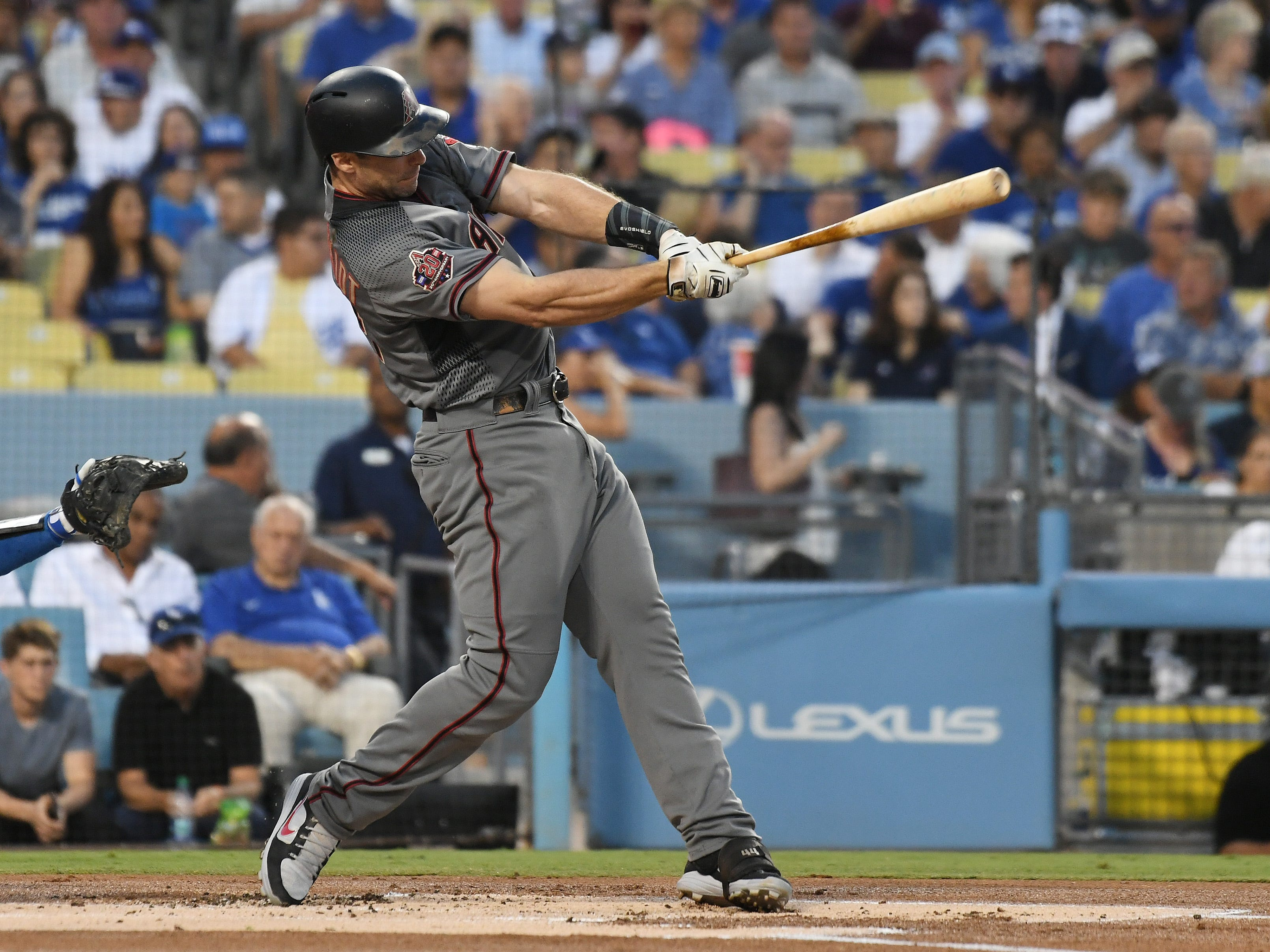 Aug 30, 2018; Los Angeles, CA, USA; Arizona Diamondbacks first baseman Paul Goldschmidt (44) hits a single against the Los Angeles Dodgers in the first inninat Dodger Stadium. Mandatory Credit: Richard Mackson-USA TODAY Sports