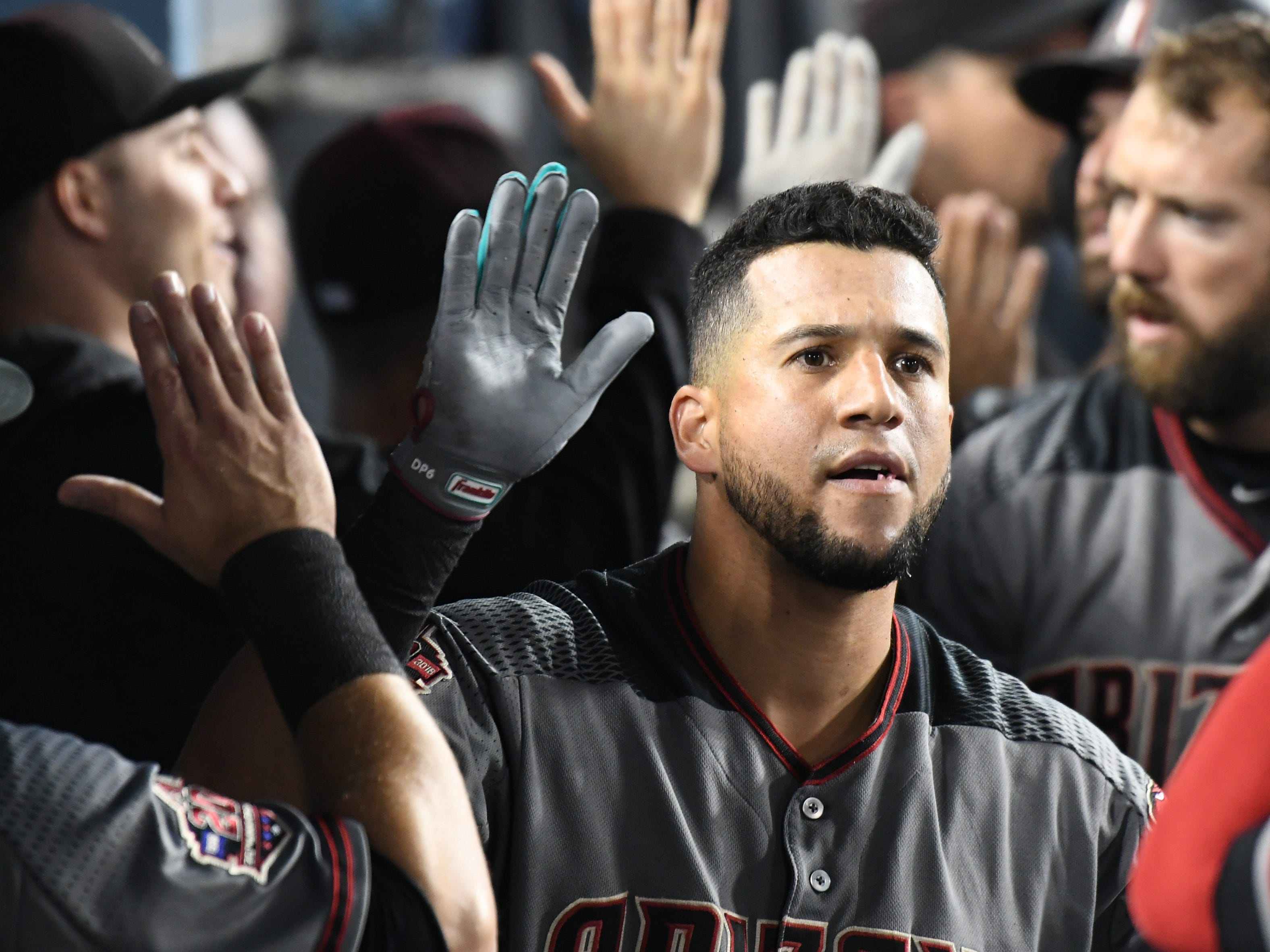 Aug 30, 2018; Los Angeles, CA, USA; Arizona Diamondbacks right fielder David Peralta (6) celebrates in the dugout after hitting a three run home run against the Los Angeles Dodgers in the fifth inning at Dodger Stadium. Mandatory Credit: Richard Mackson-USA TODAY Sports
