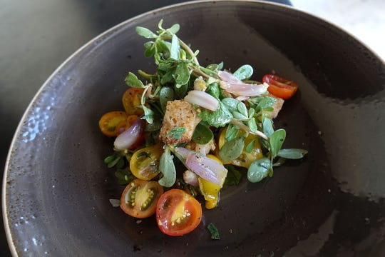 Tomato and i'itoi onion salad with purslane, wasabi arugula and roselle at Crepe Bar in Tempe.