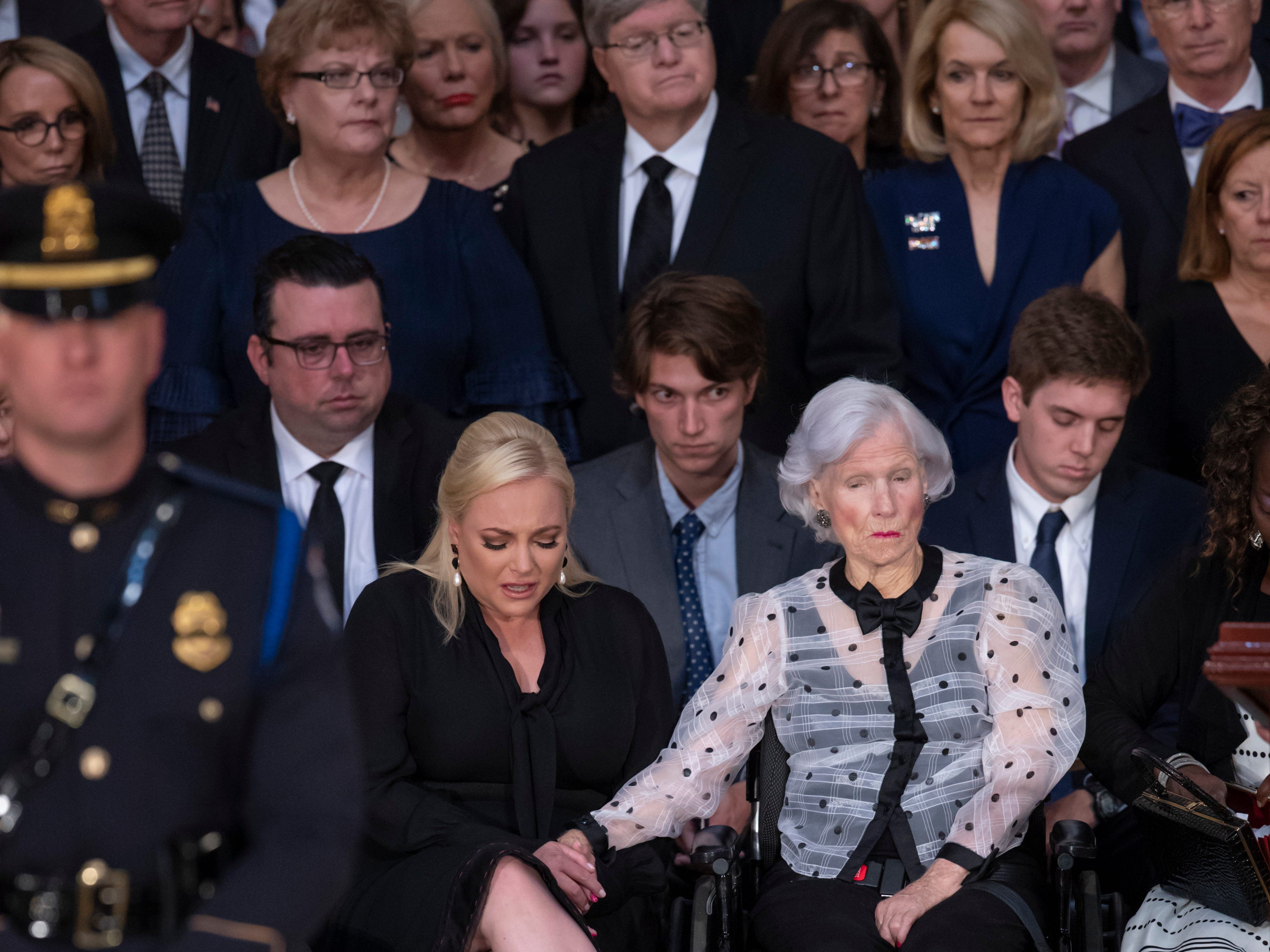 Sen. John McCain's daughter Meghan McCain is comforted by her 106-year-old grandmother Roberta McCain during a memorial at the U.S. Capitol rotunda Aug. 31, 2018, in Washington.